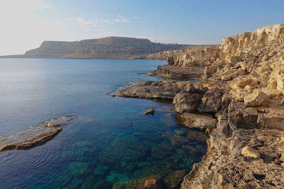 The Cape Greco in Cyprus- Rocky Hills Beauty In Nature Blue Blue Sky Blue Water Calm Cape Greco Coastline Cyprus Day Idyllic Nature No People Outdoors Rock Rock - Object Rock Formation Scenics Sea Sky Tourism Tranquil Scene Tranquility Travel Destinations Water