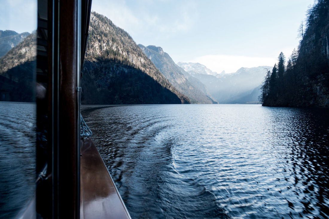 traveling by electric boat over lake Königssee Bavaria Berchtesgaden Berchtesgaden Alps Berchtesgadener Land  Blue Blue Sky Boat Day Electric Boat Germany Home Königssee Lake Mountain Nationalpark Berchtesgaden Nature No People Outdoors Sky Spring Tranquility Travel Travel Destinations Travel Photography Water