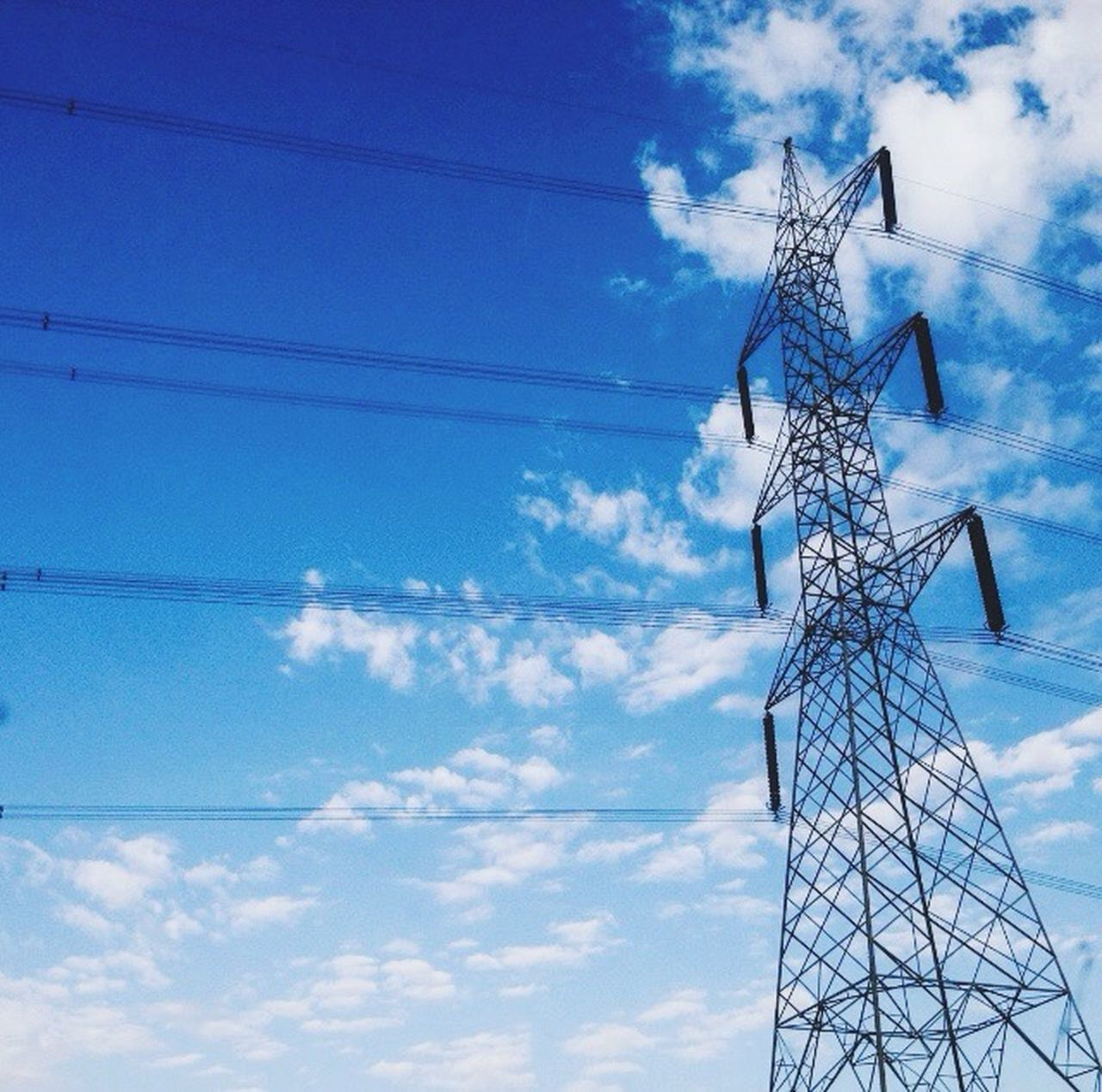 sky, low angle view, fuel and power generation, cable, cloud - sky, electricity pylon, blue, no people, day, connection, outdoors, electricity, wind power, alternative energy, technology, wind turbine, windmill, industrial windmill