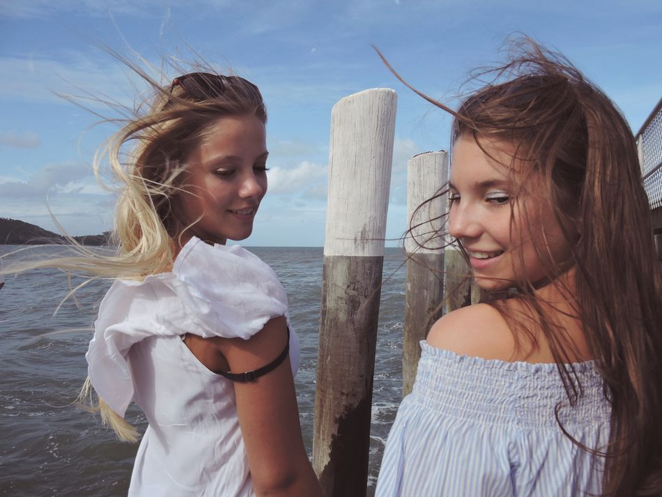 Young Two People Young Women Real People Young Adult Sky Day Sea Women Long Hair Smiling Beach Nature Togetherness Close Up Freshness Fun Freedom Enjoying Life Friendship Vacation Holiday Holidays Trip Wind