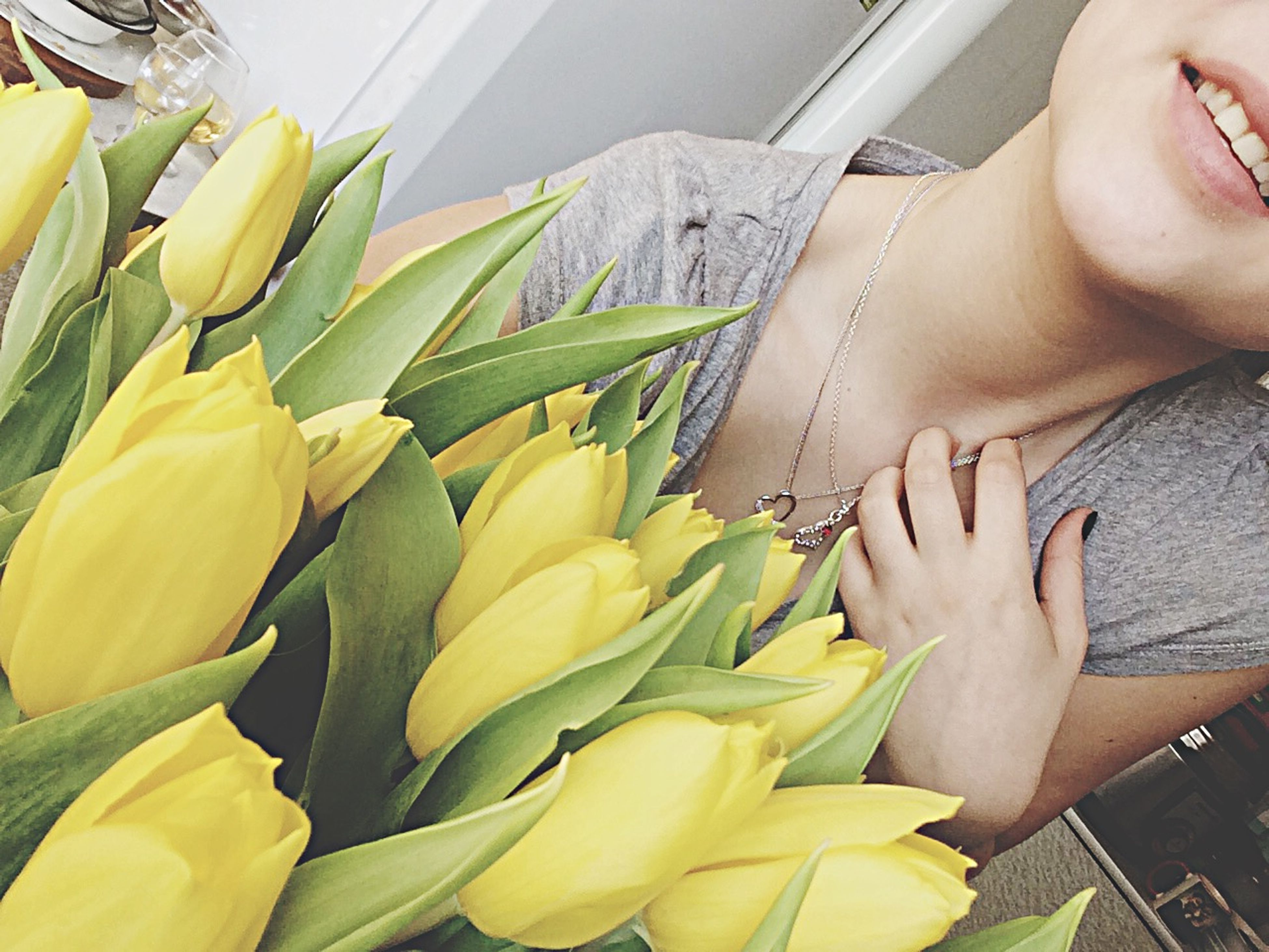 yellow, lifestyles, part of, person, low section, cropped, leisure activity, holding, flower, freshness, indoors, high angle view, day, close-up