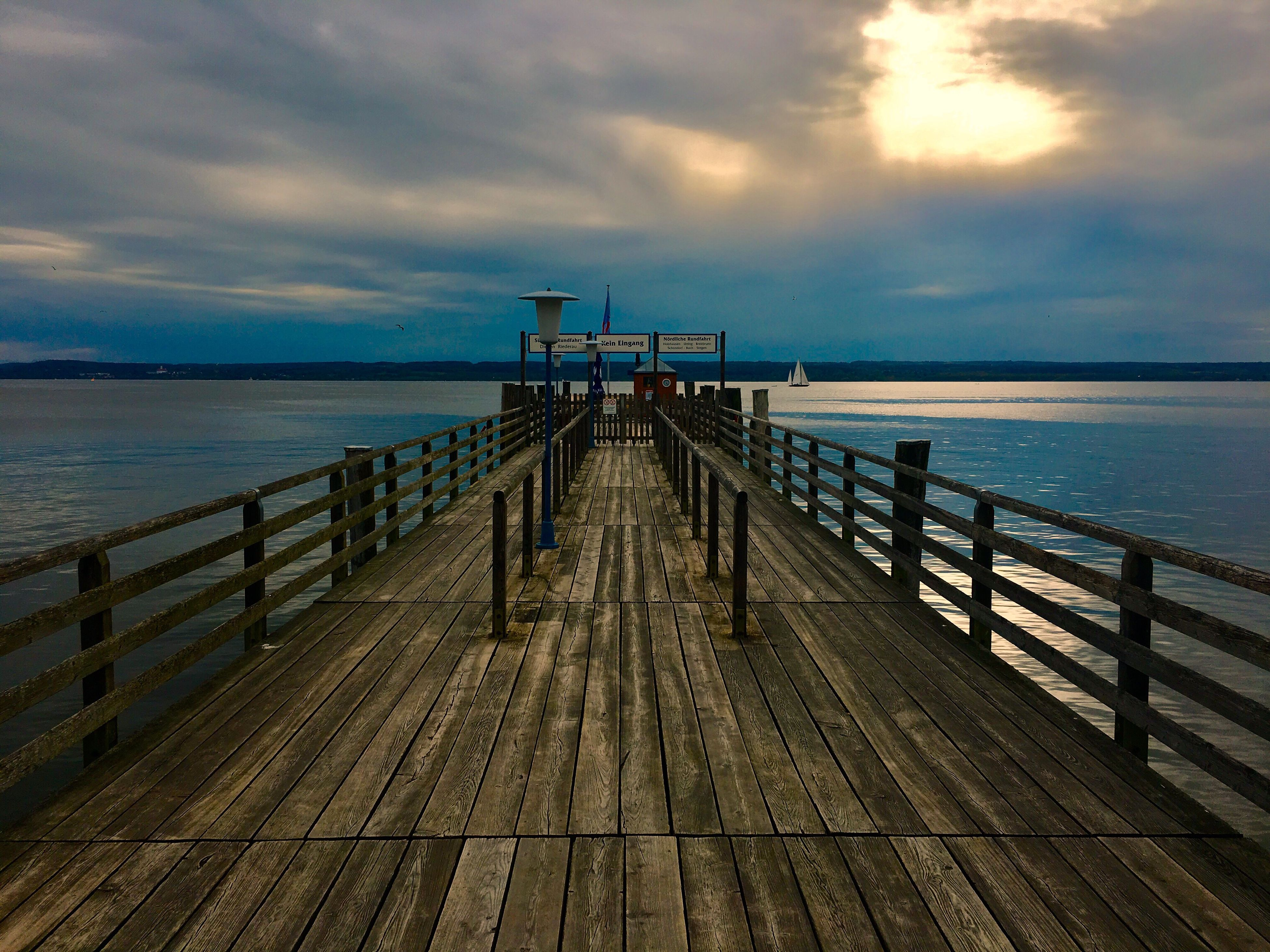 sea, water, horizon over water, pier, cloud - sky, jetty, wood - material, wood paneling, sky, nature, scenics, tranquil scene, beauty in nature, tranquility, outdoors, day, no people, sunset, built structure