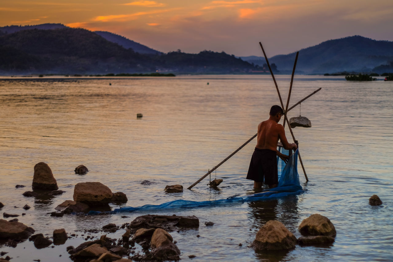 Beautiful stock photos of angeln, fishing, water, sunset, fishing net