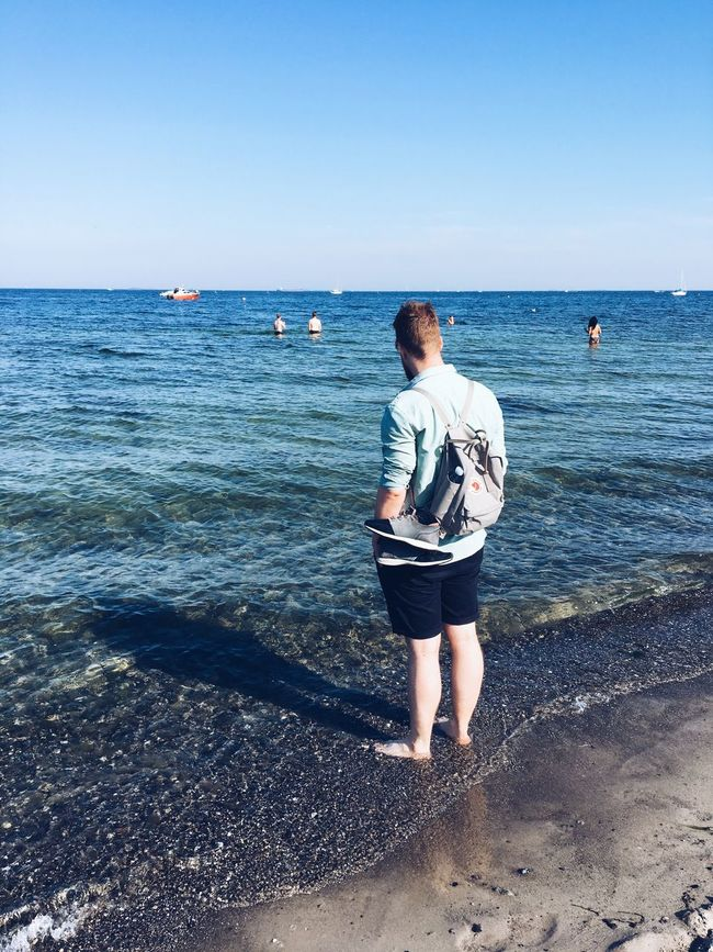 Horizon Over Water Water Sea Clear Sky Rear View Full Length Leisure Activity Lifestyles Casual Clothing Tranquil Scene Standing Scenics Tranquility Blue Summer Beauty In Nature Day Vacations Nature Outdoors Contemplating