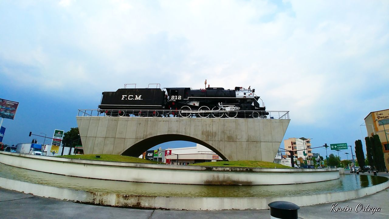 Built Structure Architecture Arts Culture And Entertainment Building Exterior Outdoors Tree Sky Day Water City Train Train - Vehicle Train Station