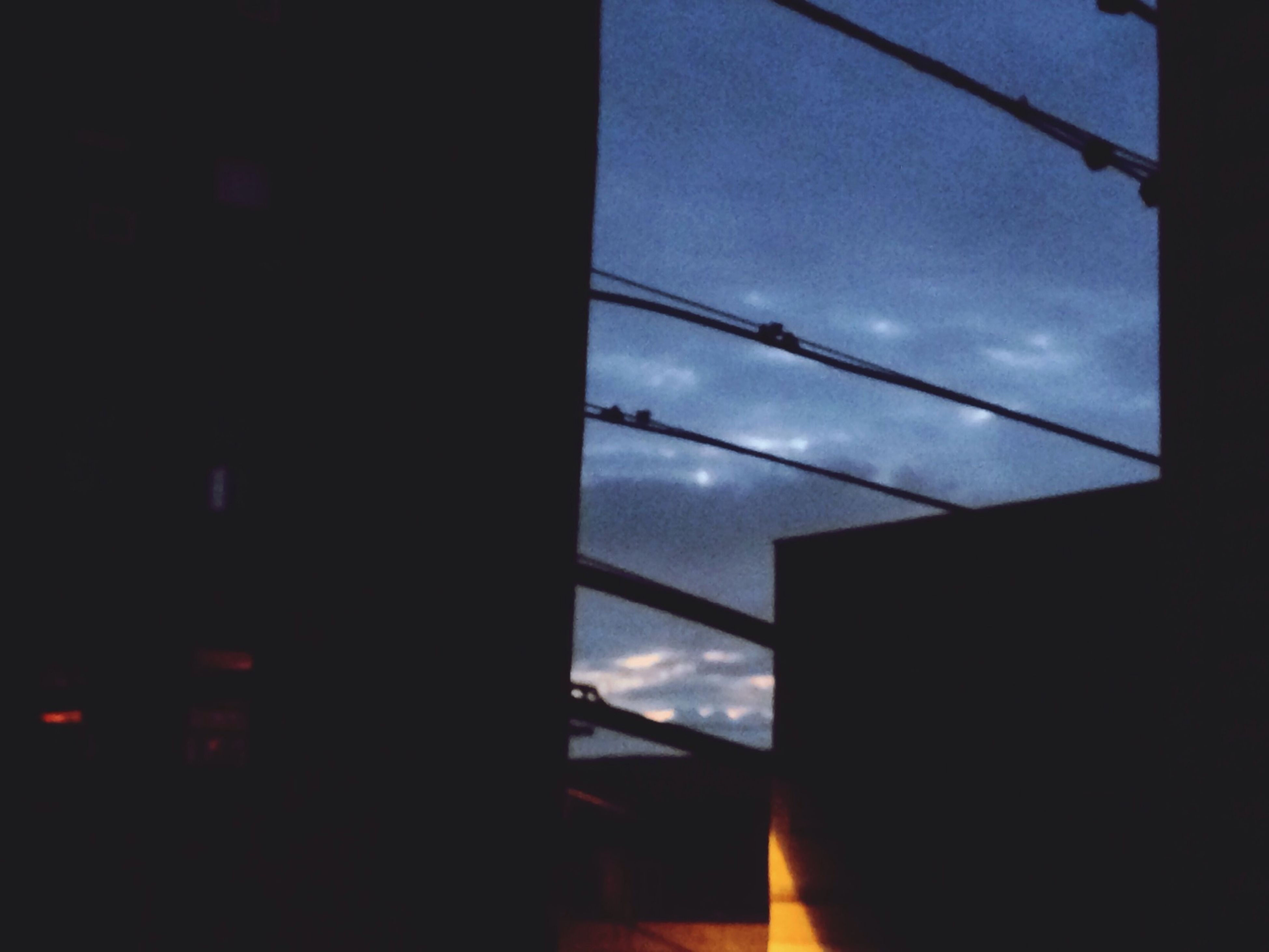 sky, low angle view, architecture, built structure, silhouette, building exterior, window, cloud - sky, dark, glass - material, cloud, sunset, building, dusk, no people, illuminated, city, indoors, blue, sunlight