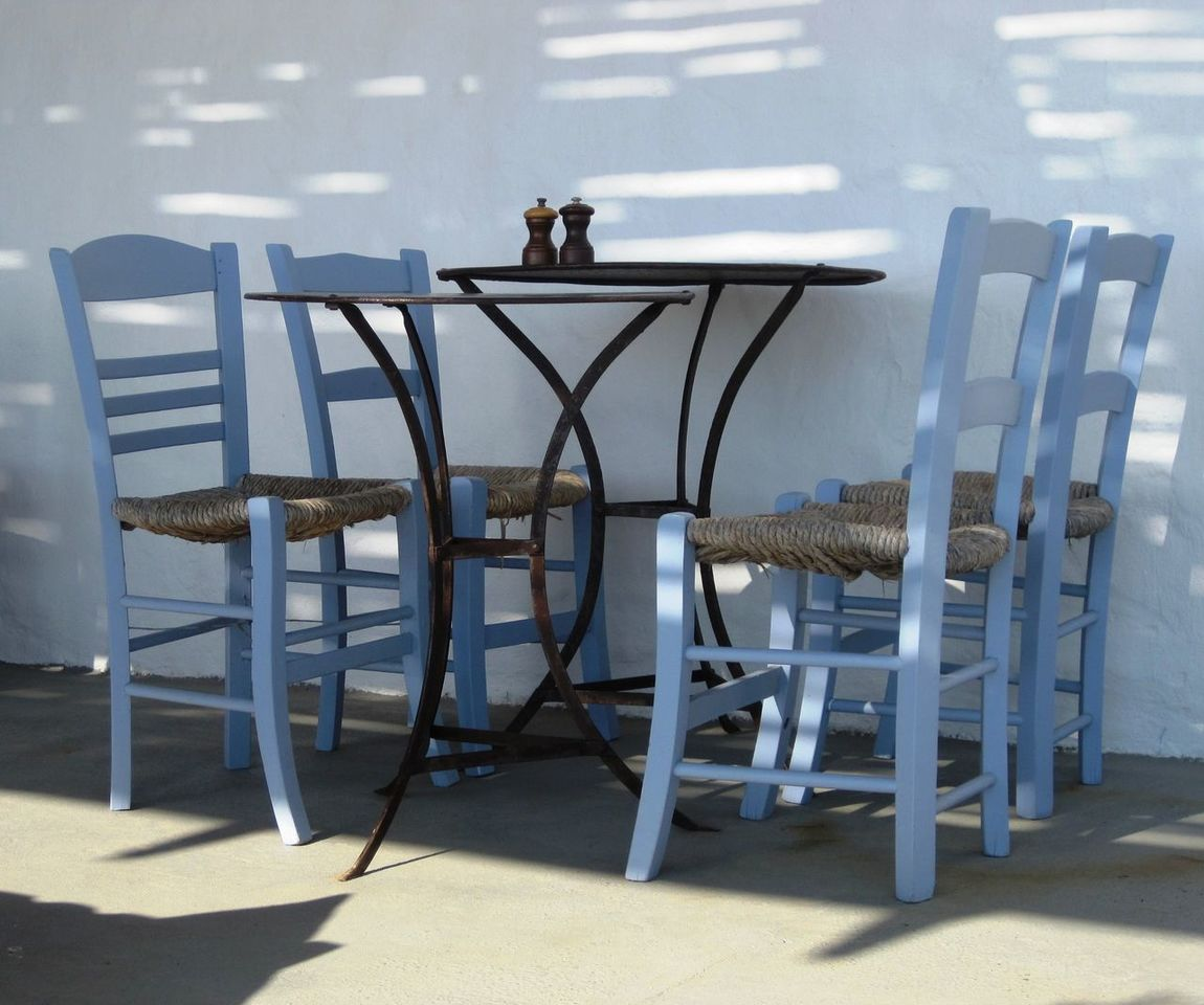 Metal Table with Four Blue Chairs Blue Blue Painted Chairs Chair Chair Day Empty Four Chairs Greek Style Metal Table No People Table Taking Photos Wooden Chairs