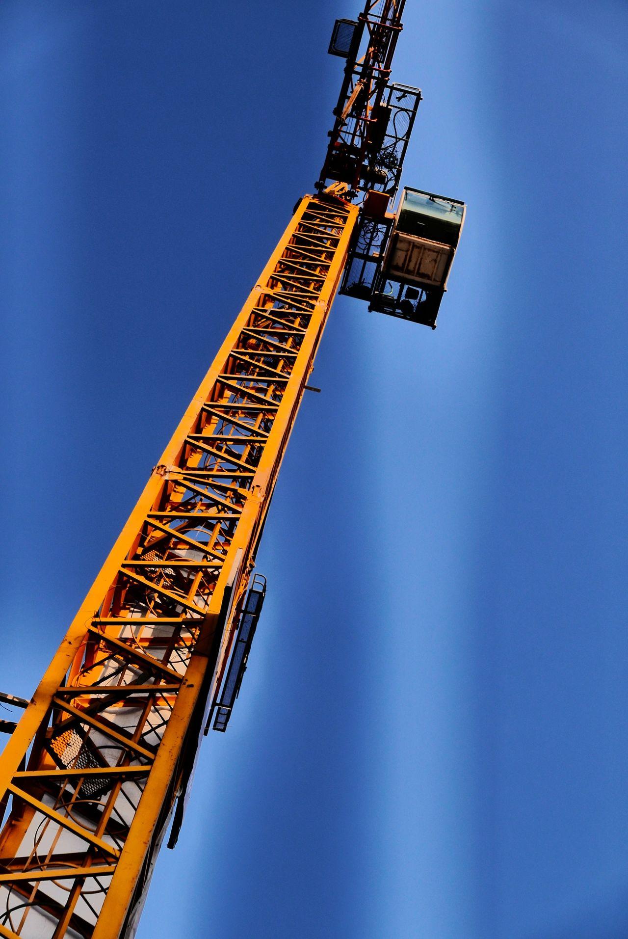 Construction crane against blue sky at dusk using filter Impressive art Filter Blue Sky Crane Construction Construction Crane