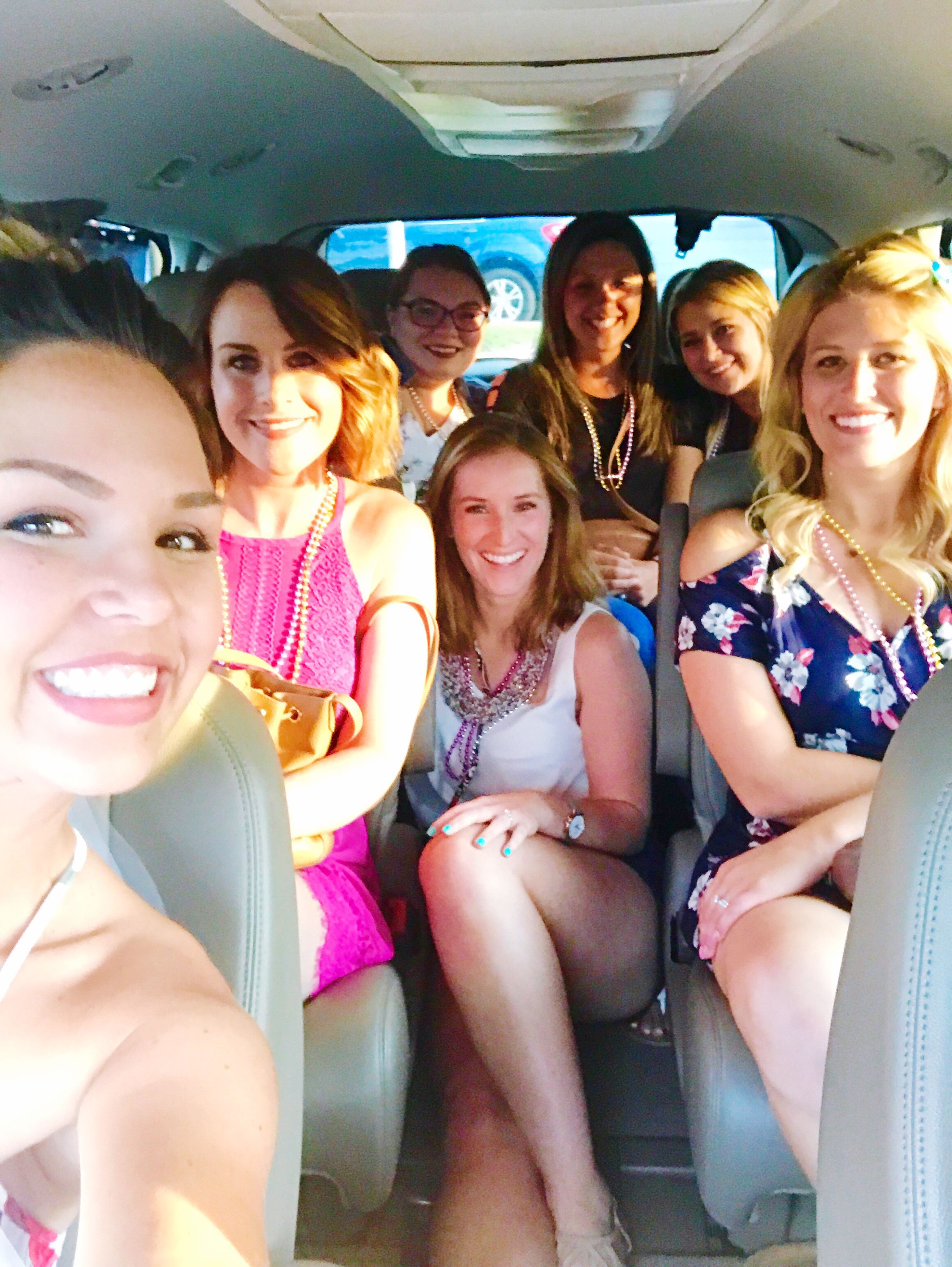 looking at camera, sitting, vehicle interior, portrait, smiling, transportation, happiness, real people, fun, leisure activity, friendship, young women, young adult, casual clothing, cheerful, togetherness, day, car interior, vehicle seat, boys, large group of people, blond hair, outdoors, people