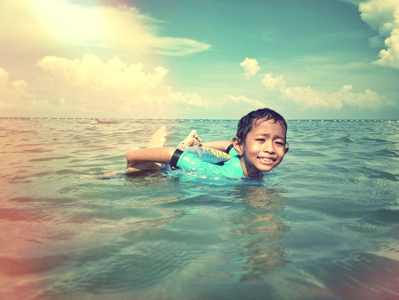 Water Smiling Vacations Summer Sea Enjoyment Cheerful Fun Happiness Cloud - Sky Outdoors Leisure Activity People Portrait Relaxation Sky Swim Sea Life Floating On Water Nature Human Body Part Boy Port Dickson Malaysia Negeri Sembilan