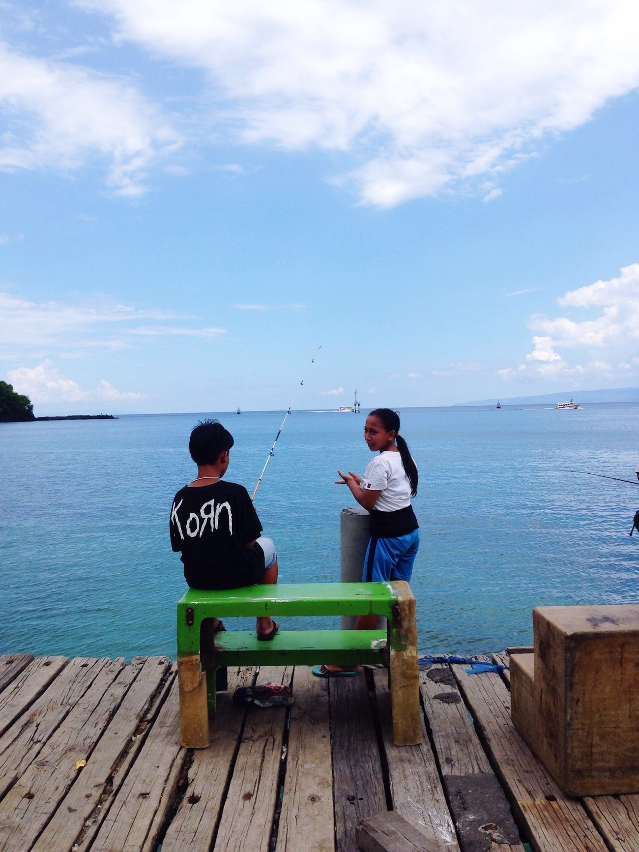 Bali INDONESIA Kids Fishing Harbour Korn Metal Sea