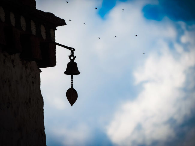 Dzong Bell Silhouette Silhouette_collection Architecture Archtecturalphotography Architectural Feature Architecturephotography Sky Blue Sky Bhutanese Culture Bhutan Eyeemphotography Eye4photography  EyeEmNewHere EyeEm Gallery Bhutanese Architecture Architecturelovers Art And Craft Art Is Everywhere Bhutanese Hanging Sky Cloud - Sky Silhouette Flying Mid-air Day Outdoors No People