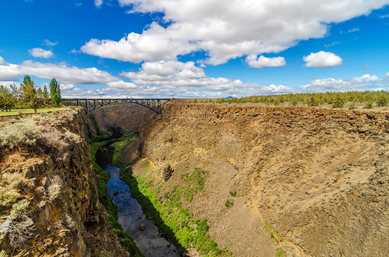 View of Crooked River canyon in Central Oregon with a beautiful blue sky Architecture Bend Bridge Central Oregon Colorful Deschutes Deschutesriver  Forest Grass Landscape Nature Oregon Outdoors Park River Rushing Structure Tourism Travel Tree United States View Water Wild Wood
