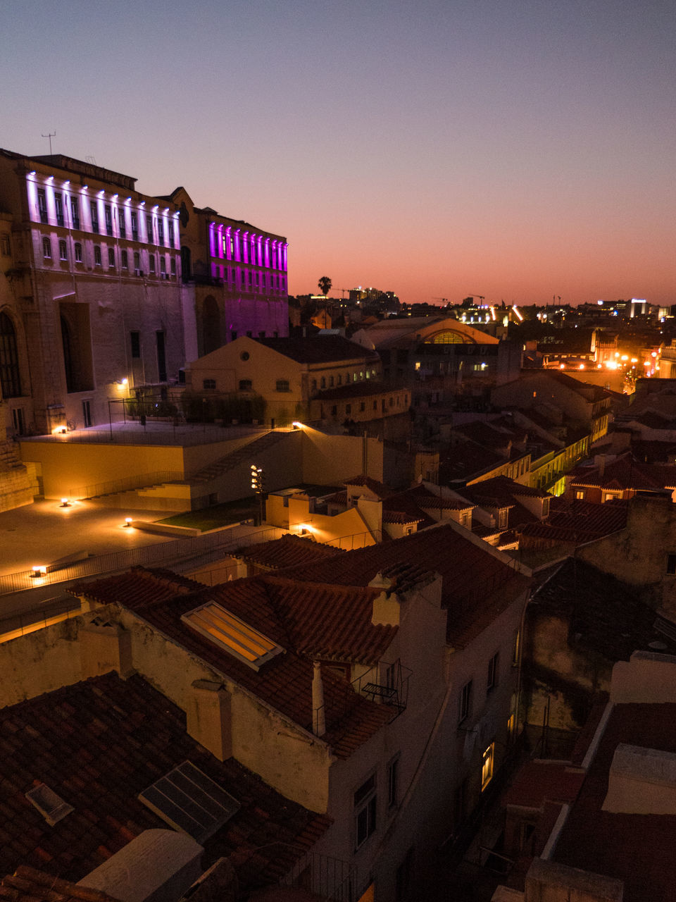 architecture, building exterior, built structure, no people, illuminated, city, night, outdoors, cityscape, sunset, sky