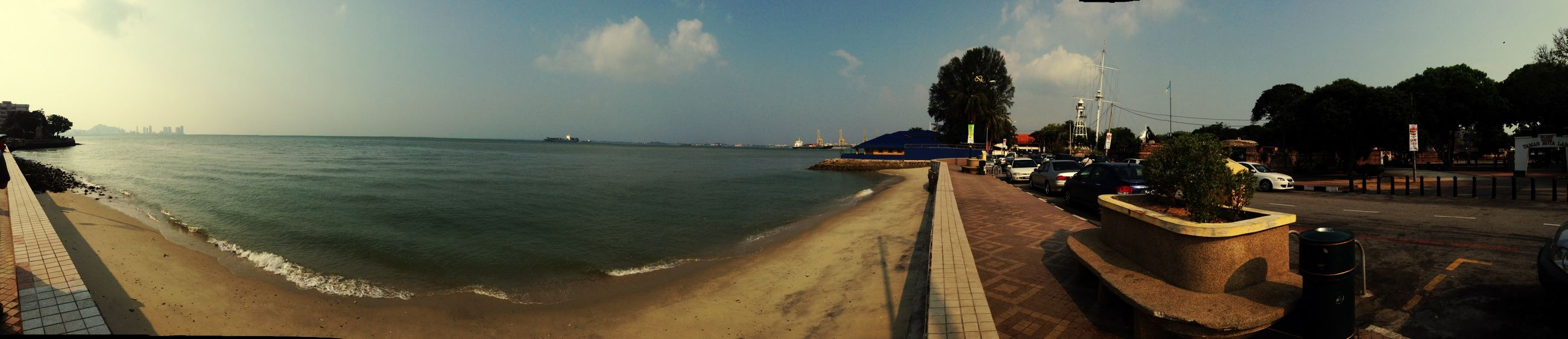 sea, water, beach, sky, shore, panoramic, horizon over water, sand, transportation, scenics, incidental people, beauty in nature, nature, tranquility, coastline, sunlight, nautical vessel, tranquil scene, mode of transport, travel