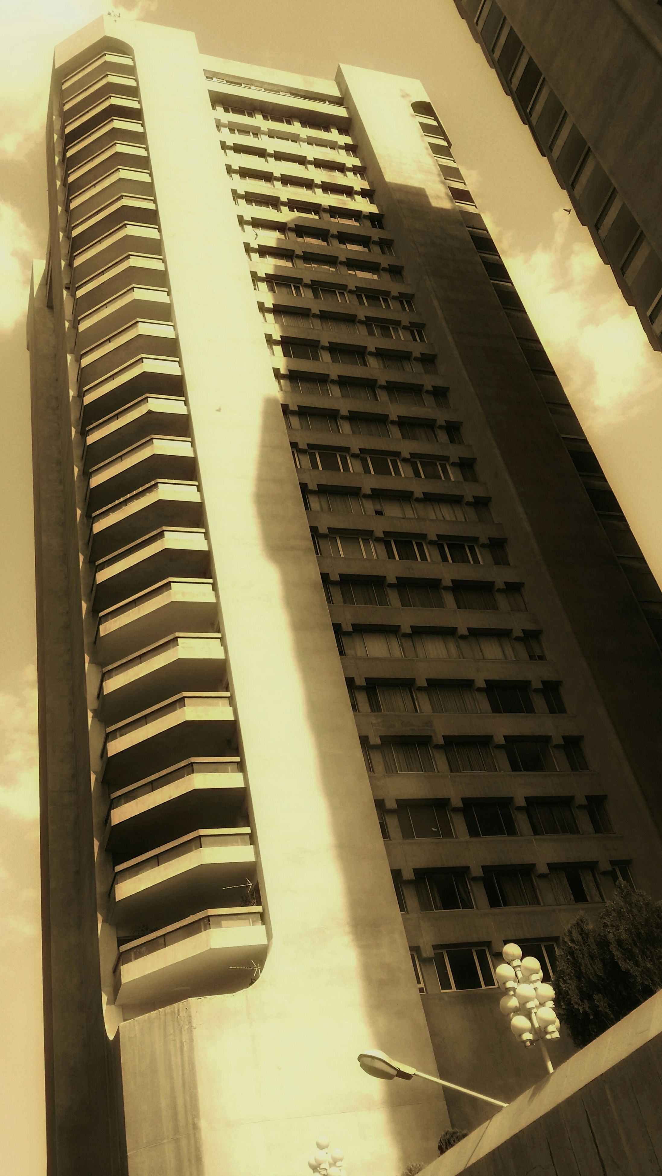 architecture, building exterior, built structure, modern, skyscraper, city, office building, building, tall - high, low angle view, high angle view, no people, tower, tall, tilt, day, outdoors, city life, sky, residential building