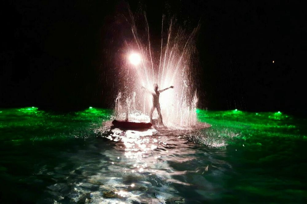 Sommergefühle Night Water Reflection Arts Culture And Entertainment Motion Vacations Illuminated One Person People Sky Outdoors Beliebte Fotos Green Background First Eyeem Photo EyeEm Selects Spaß Haben  Ferienspaß Children Photography Waterdrops Looking At Camera