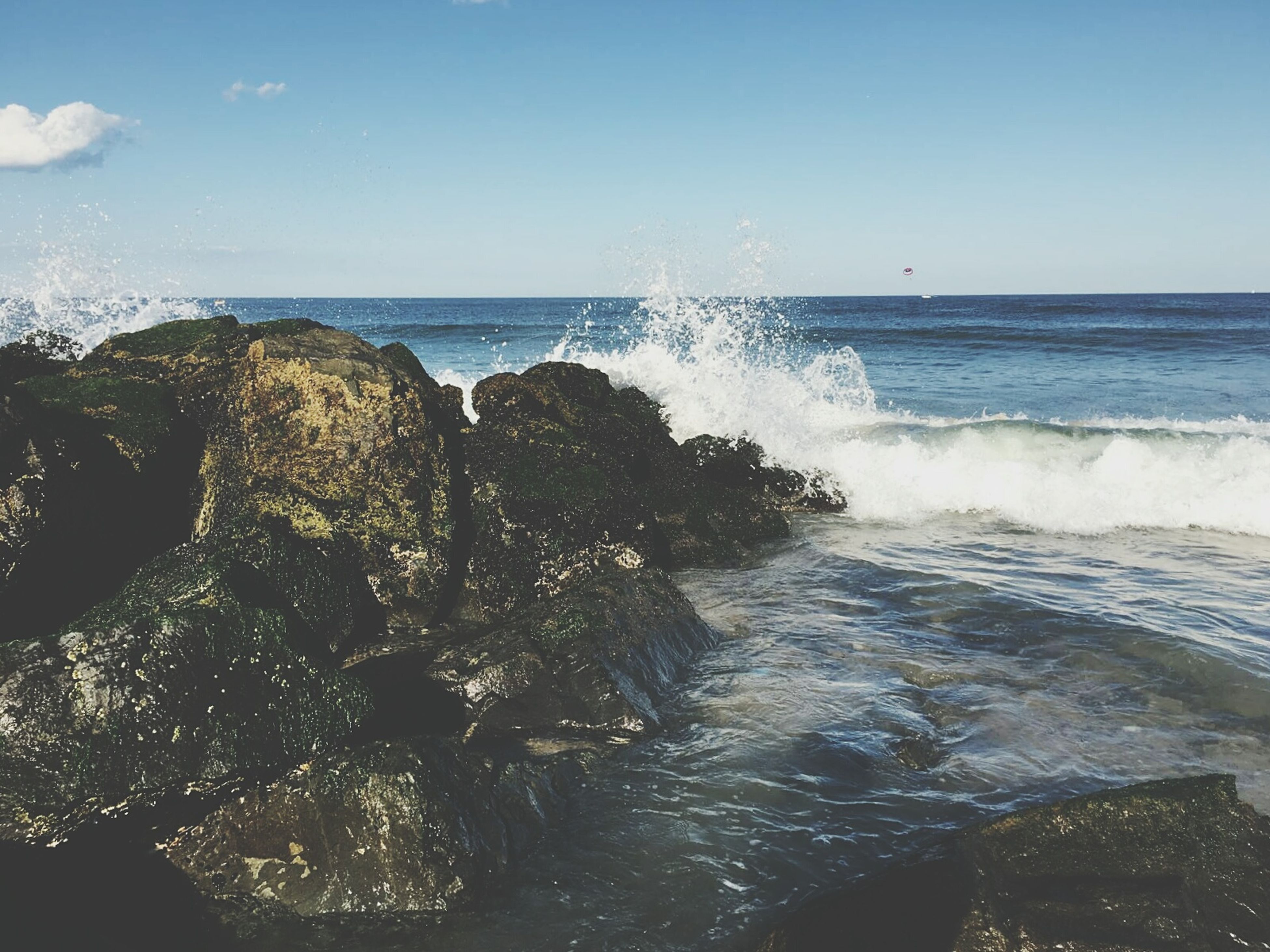 sea, water, horizon over water, wave, motion, splashing, power in nature, scenics, beauty in nature, surf, rock - object, nature, rock formation, sky, majestic, non-urban scene, tranquil scene, tranquility, outdoors, geology, seascape, rocky, rock, no people, coastal feature, remote