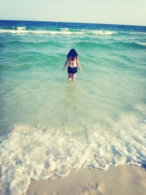 Getting a tan at Pensacola Beach by Diana Martinez