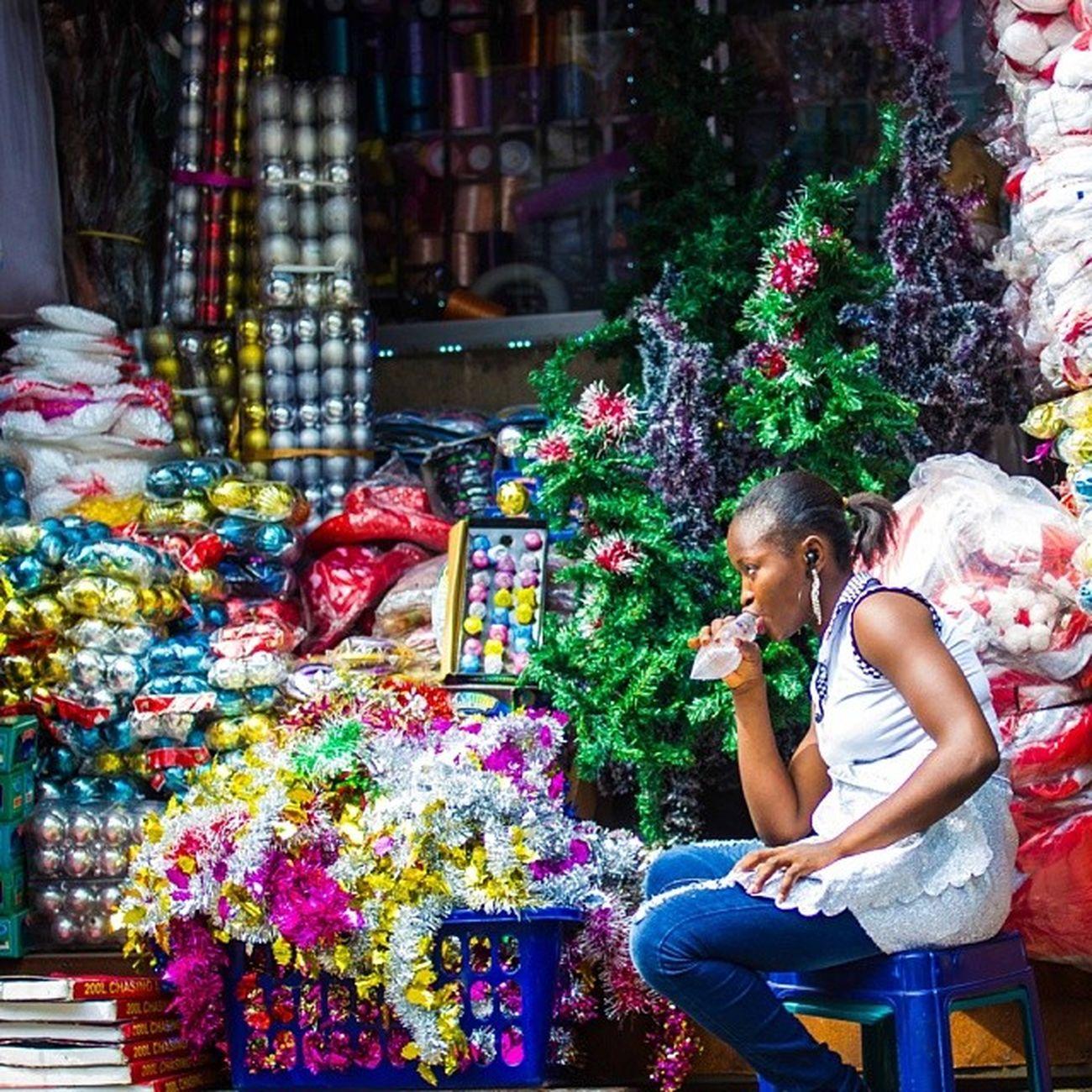 Christmas shop in Lagos. ChristmasInLagos LagosIsland Lagos Nigeria nigerianwomen africanwoman africa streetphotography