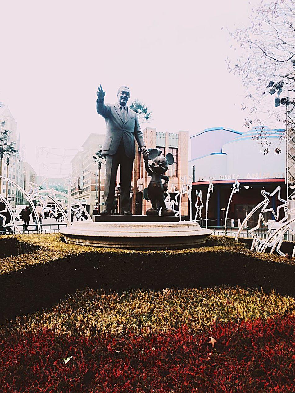 Walter and mickey 😍 Paris Disneyland Paris Walterdisney Flowers Statue
