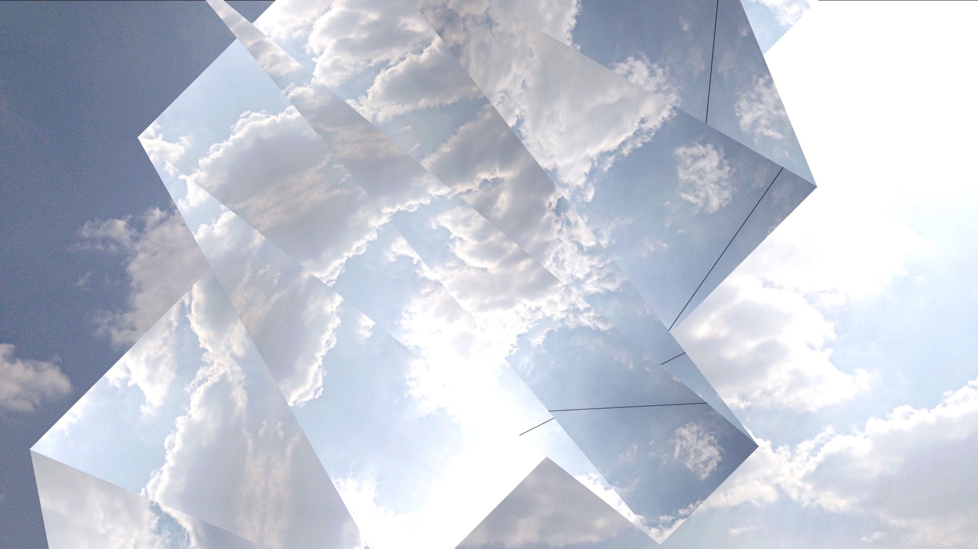low angle view, architecture, built structure, building exterior, sky, modern, pattern, blue, sunlight, day, directly below, no people, shape, tower, glass - material, geometric shape, design, skyscraper, outdoors, cloud - sky