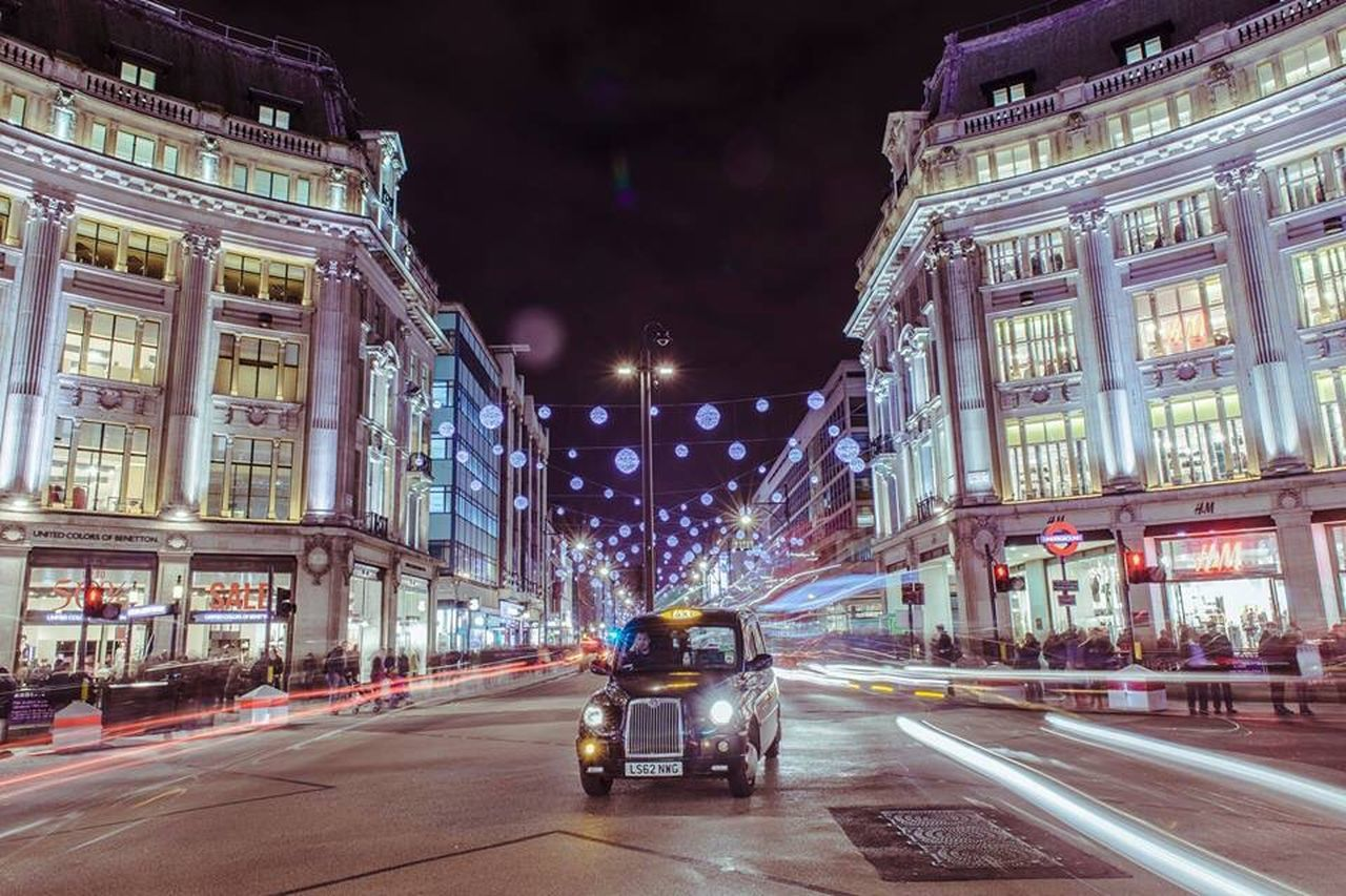 illuminated, architecture, night, building exterior, built structure, city, transportation, car, street, land vehicle, road, city street, city life, mode of transport, travel destinations, travel, street light, lighting equipment, incidental people, the way forward