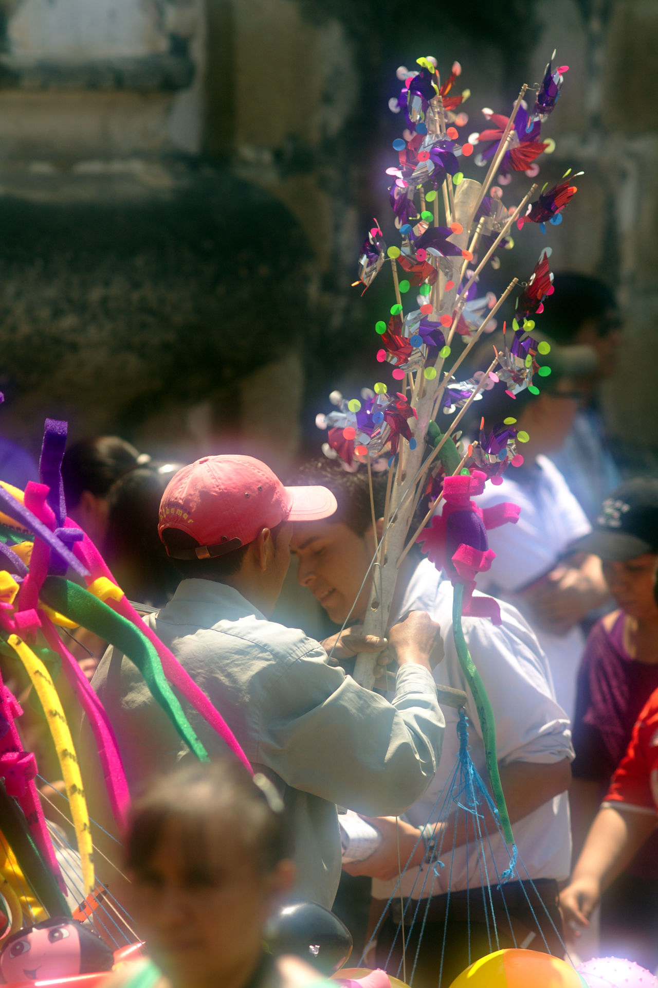 Adult Baseball Cap Celebration Colorful Gifts Crowd Day Fine Art Photography Flea Markets Market Outdoors People Red Hat Sales Person Still Life Street Photography Street Sales Tradition Travel Travel Destinations Traveling Salesman Urban Exploration Urban Photography Western Guatemala