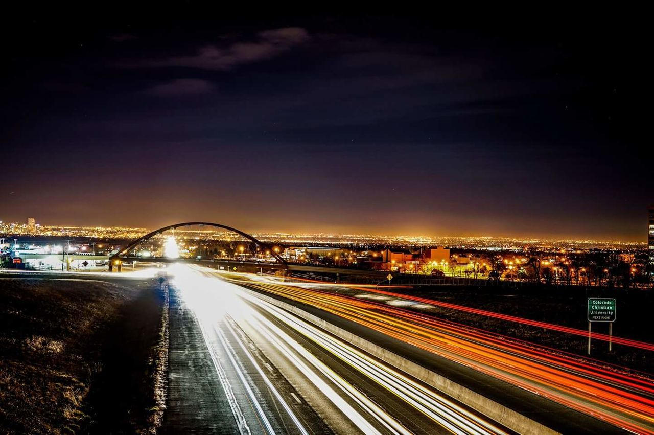 long exposure, night, motion, light trail, speed, illuminated, blurred motion, architecture, transportation, built structure, city, bridge - man made structure, road, sky, no people, outdoors, building exterior, high street, cityscape