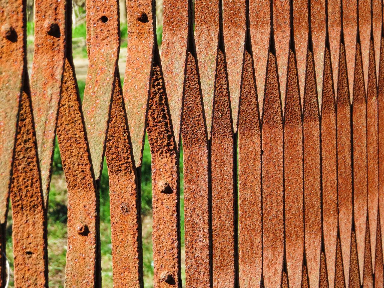 Close-up Geometric Shape Ironwork  No People Orange Outdoors Pattern Railing Row Rusty Metal Sunlight Textured