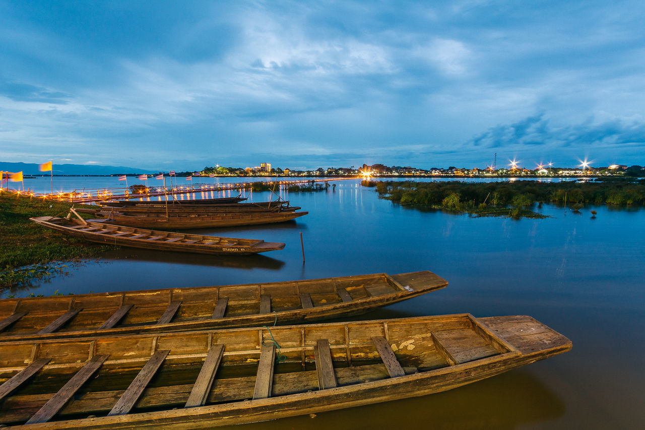 PHAYAO, THAILAND - JULY 19, 2016: The bamboo bridge, The bamboo bridge of Wat Ti Lok Aram temple in kwan phayao off freshwater lake of Thailand. Day is the important Buddhist. Architecture ASIA Bamboo Bridge Blue Buddhist Built Structure City Cloud Cloud - Sky Cloudy Day Important Kwan Phayao Nature No People Outdoors Scenics Sky Temple Thailand Tourism Tranquility Travel Destinations Wat Ti Lok Aram Water