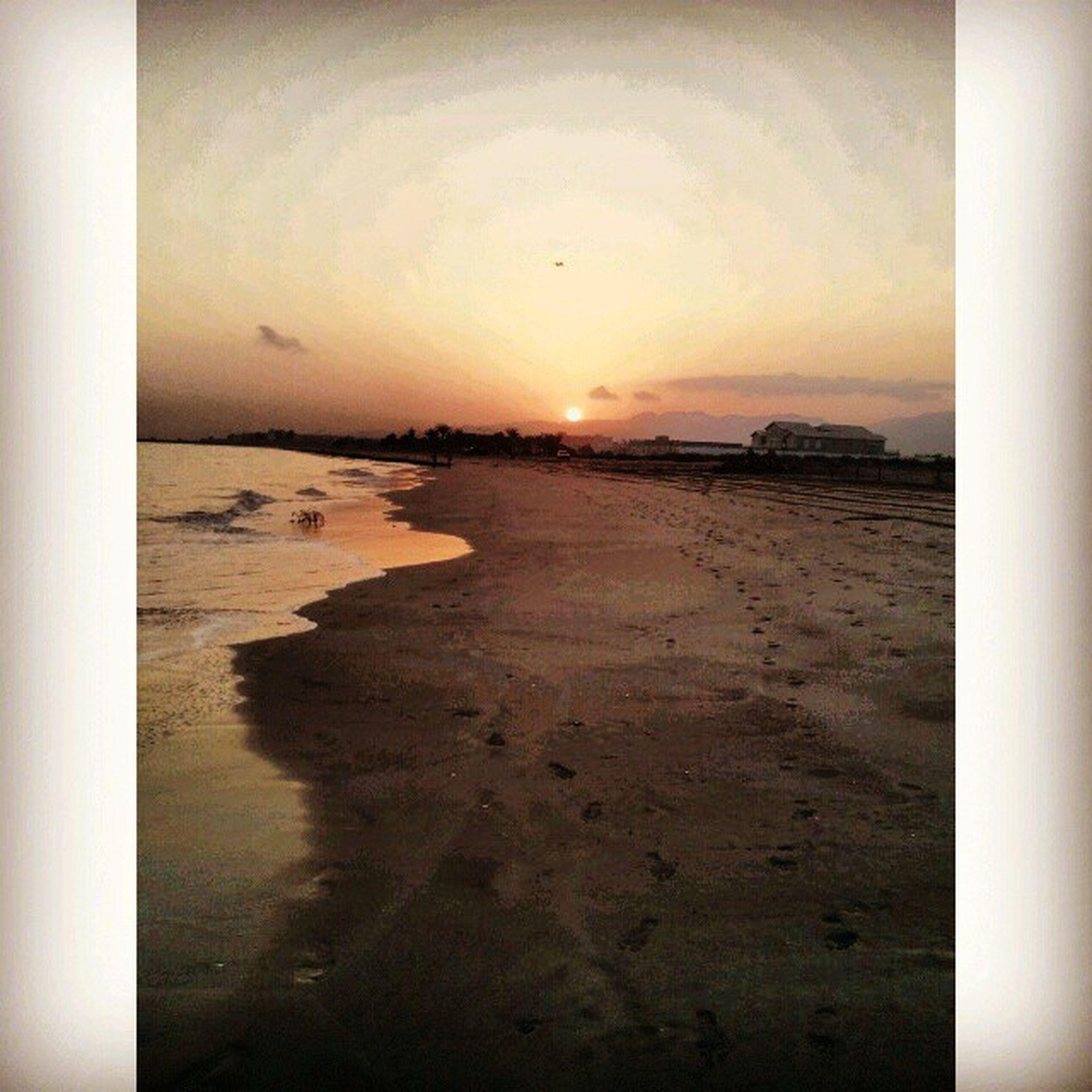 sea, sunset, beach, horizon over water, water, shore, sand, scenics, tranquil scene, tranquility, beauty in nature, sun, sky, orange color, nature, idyllic, wave, sunlight, coastline, transfer print