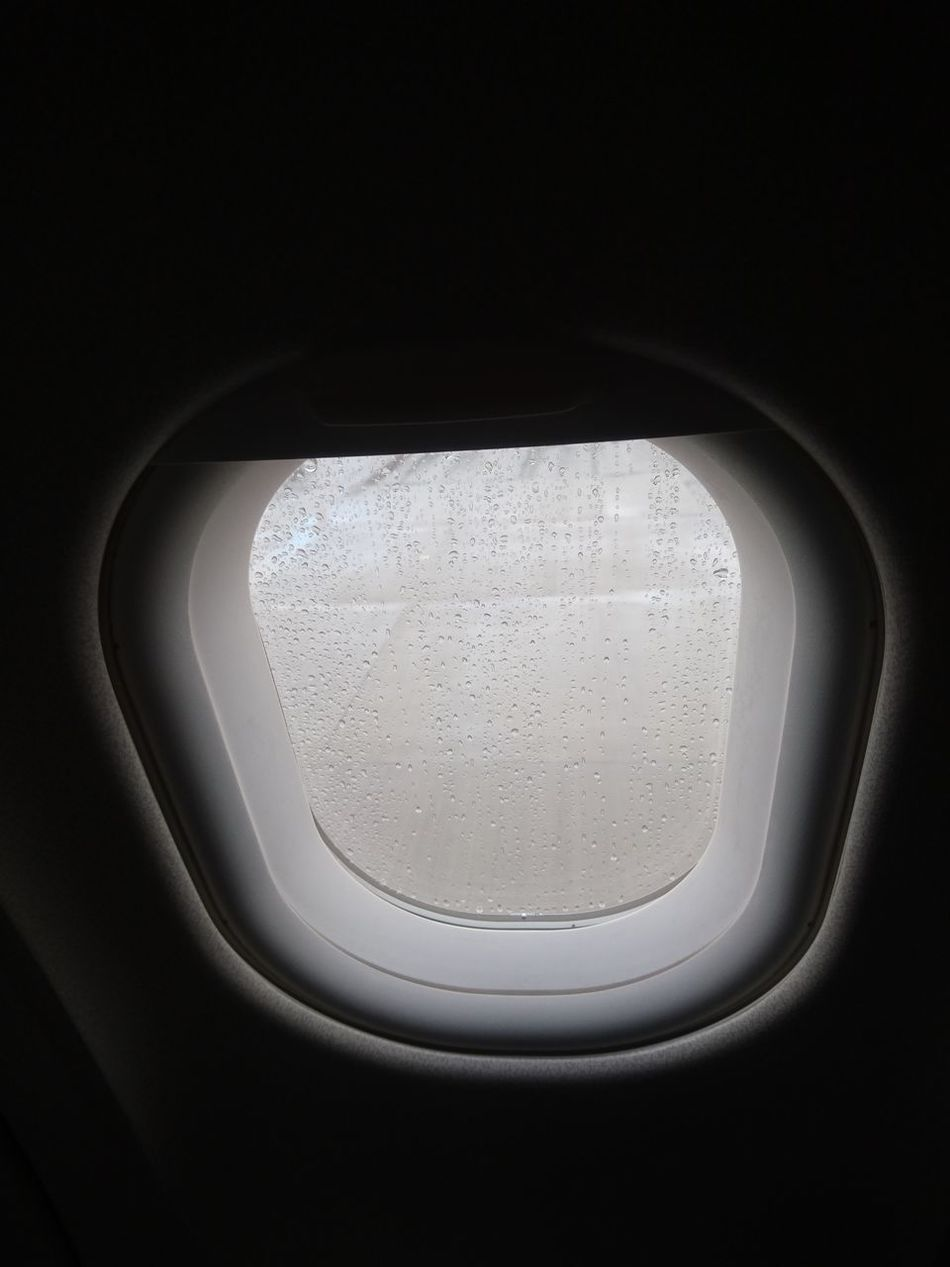 Window No People Close-up Black Background Sparse Day Rain Rain Drops Airplane Airplane Window Airplane Window View Concrete Floor Wet