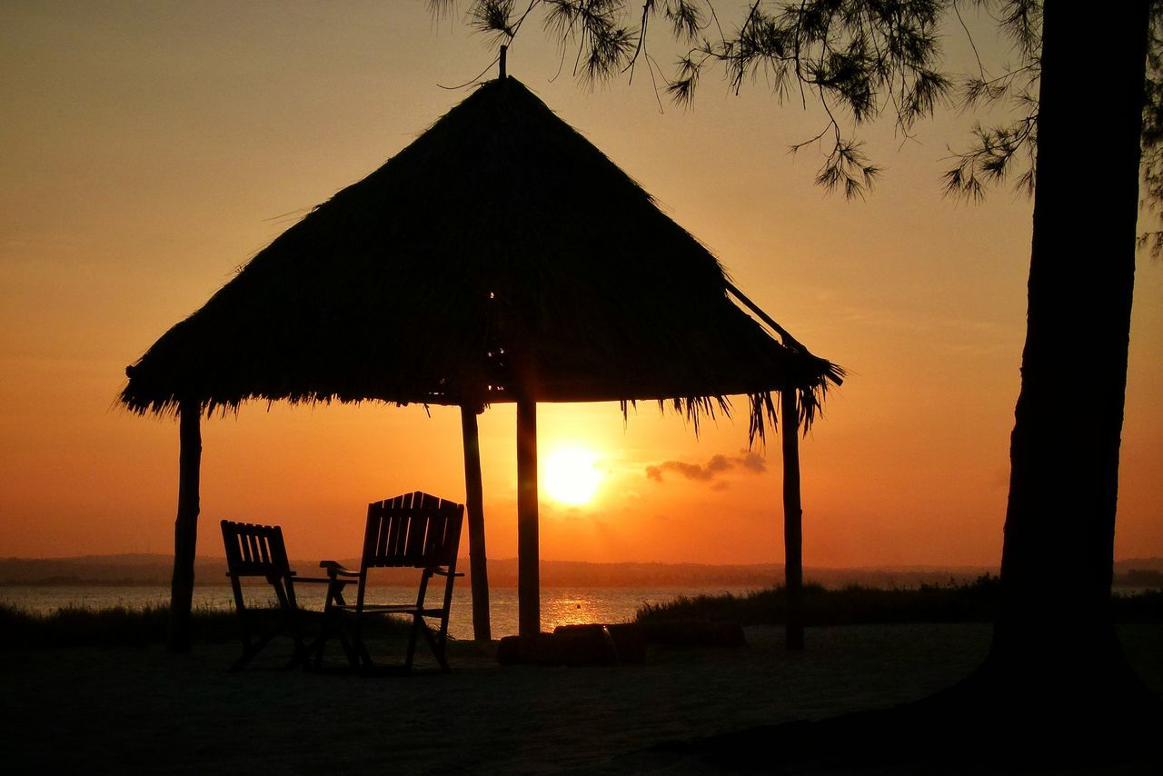 Mbudya Island Tanzania Sunset Hut Chairs Tree Silhouette Sunset Silhouettes The Great Outdoors - 2016 EyeEm Awards Summer Views Traveling Travel The Essence Of Summer 43 Golden Moments