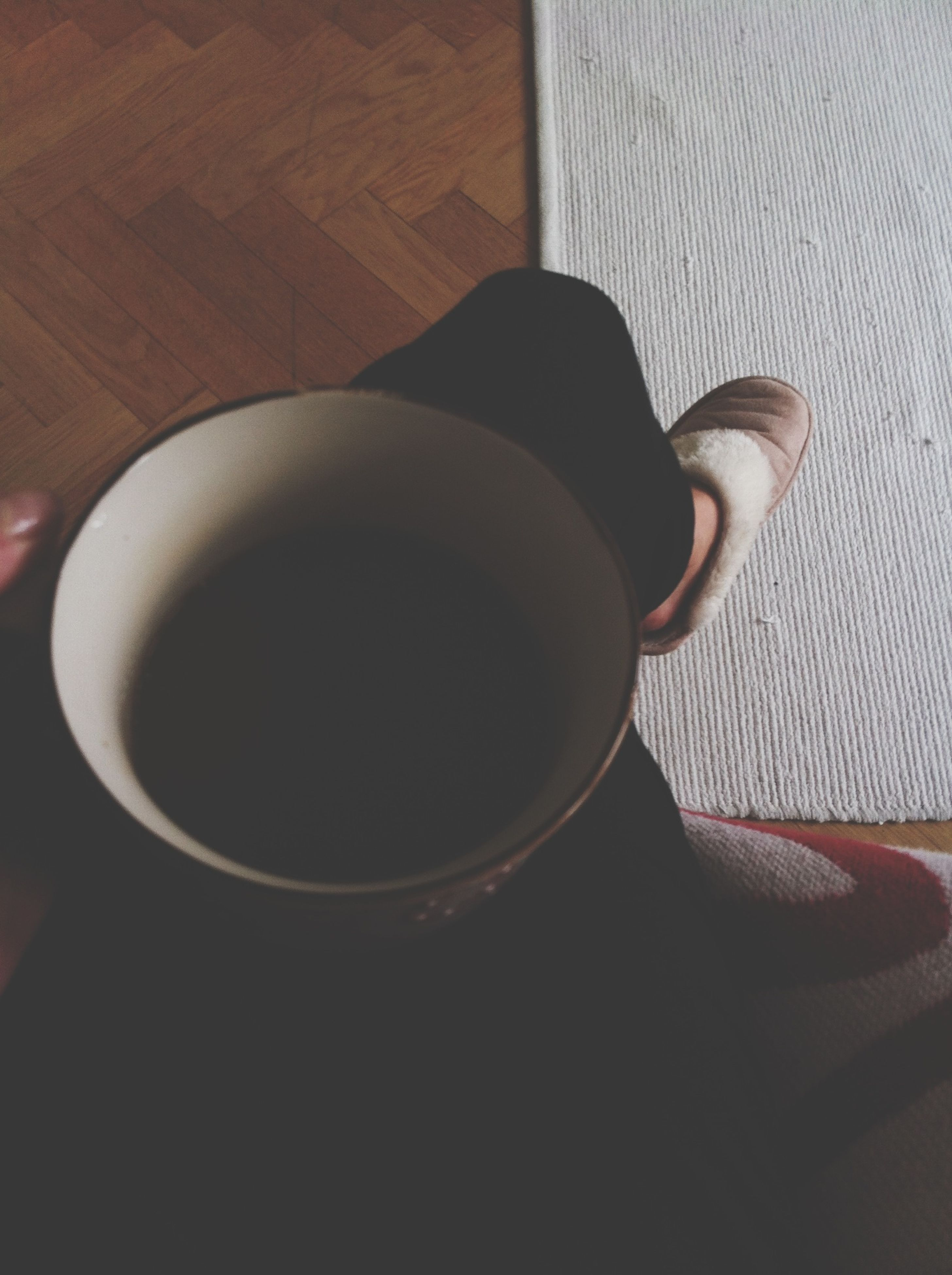 indoors, coffee cup, drink, table, coffee - drink, refreshment, high angle view, cup, still life, coffee, food and drink, close-up, home interior, directly above, shadow, wood - material, day, tea cup