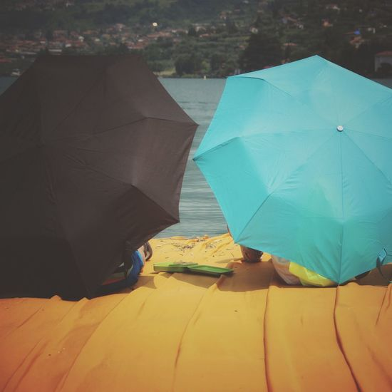 Walking on the Floating piers   People Tailored To You Golden Moments  Point Of View Christo And The Floating Piers Sunshine Getting Inspired Original Experiences The Essence Of Summer Edge Of Imagination Still Life Fine Art Lake Feel The Journey The Floating Piers Close-up Umbrellas Relaxing The OO Mission Showcase July 43 Golden Moments Lago D'Iseo EyeEm Italy  