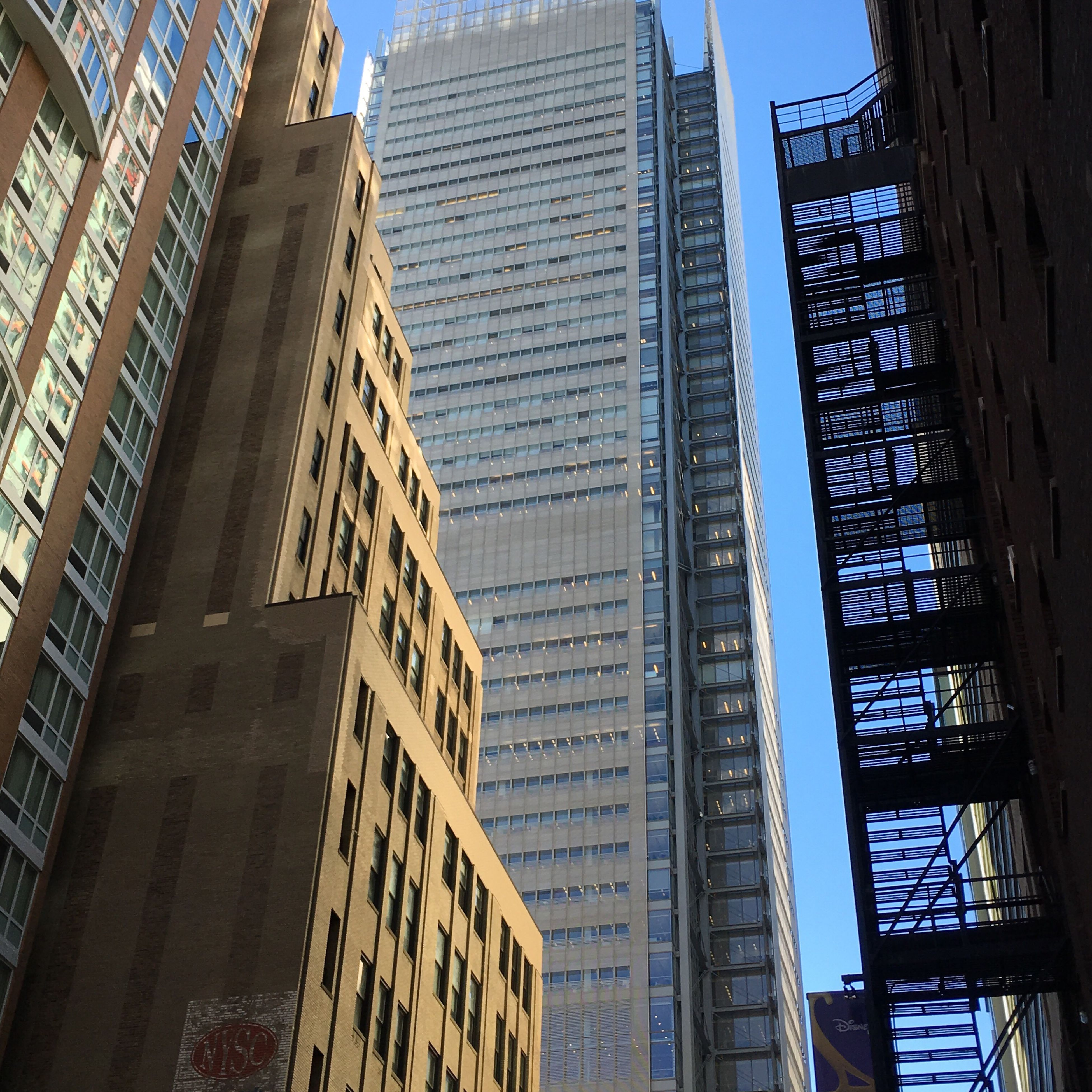 architecture, built structure, building exterior, low angle view, city, skyscraper, modern, tower, tall - high, office building, building, capital cities, glass - material, city life, travel destinations, window, sky, day, no people, famous place