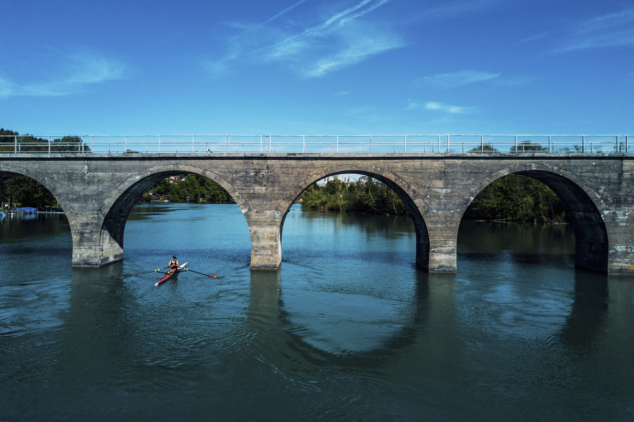 Arch Bridge - Man Made Structure Canoe Canoe Paddling Canoeing Connection Day One Person Outdoors River Sports Transportation Water Waterfront