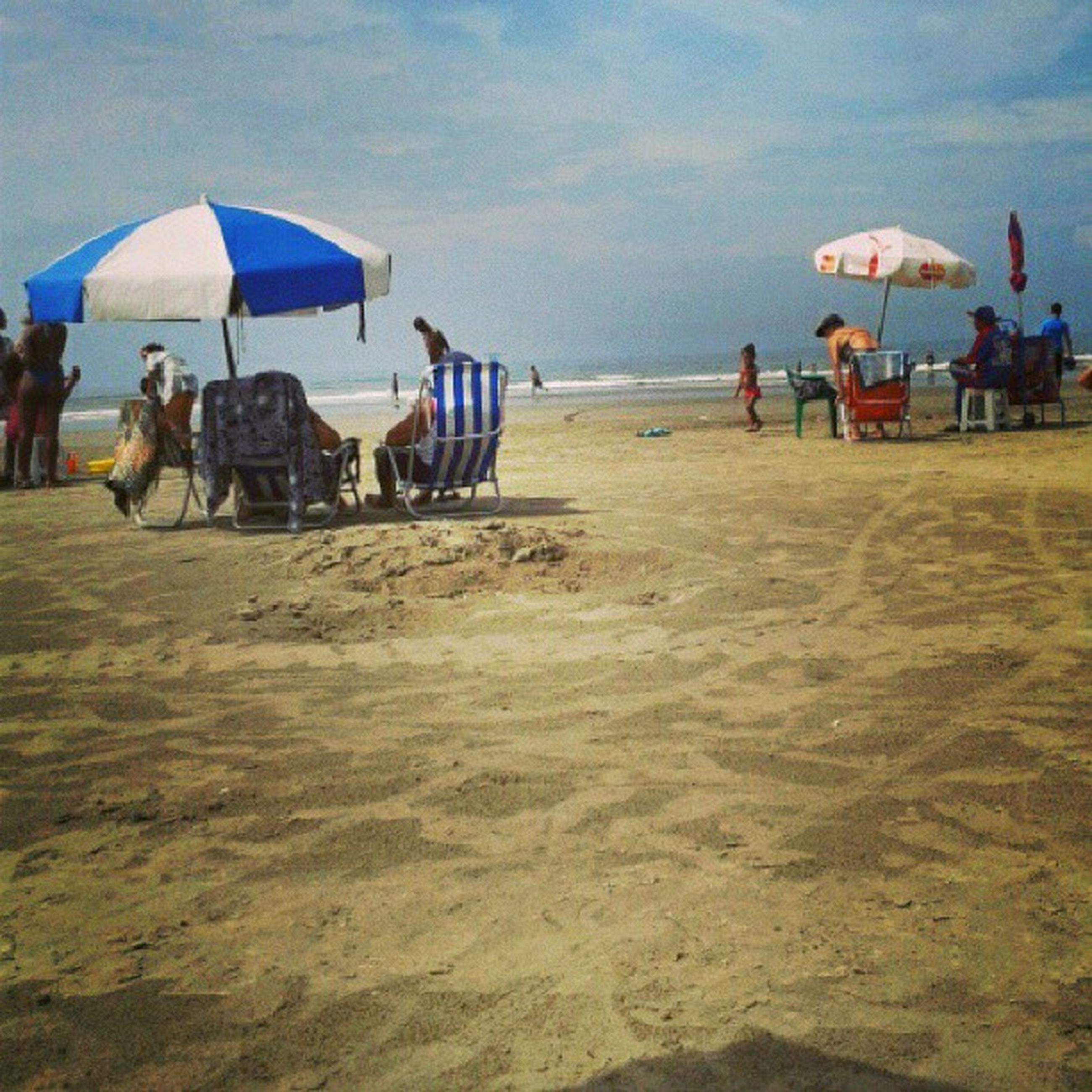 beach, sea, sand, large group of people, water, shore, vacations, leisure activity, lifestyles, person, men, horizon over water, beach umbrella, mixed age range, sky, enjoyment, tourist, summer, tourism