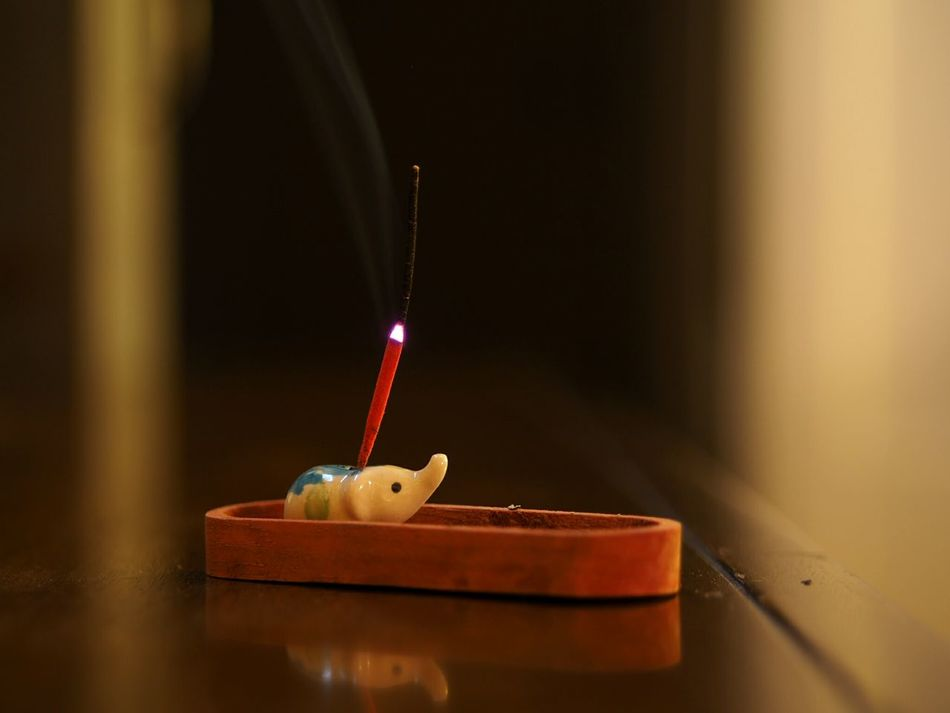 Indoors  Still Life Close-up Indulgence Surface Level Focus On Foreground Burning Smoke Incense Incense Sticks Incenseholder Baby Elephant Shallow Depth Of Field Glossy Wooden Texture Mood Scent Bokeh Ceramic Open Edit Reflection Interior Decorative Warm Light Ashes