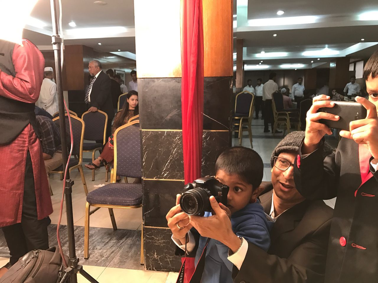 Photographer Photography Themes Camera - Photographic Equipment Photographing The Media Men Photographer Business Adults Only Occupation Adult Women Working People Television Camera Filming Film Industry Only Men Young Adult Microphone Technology