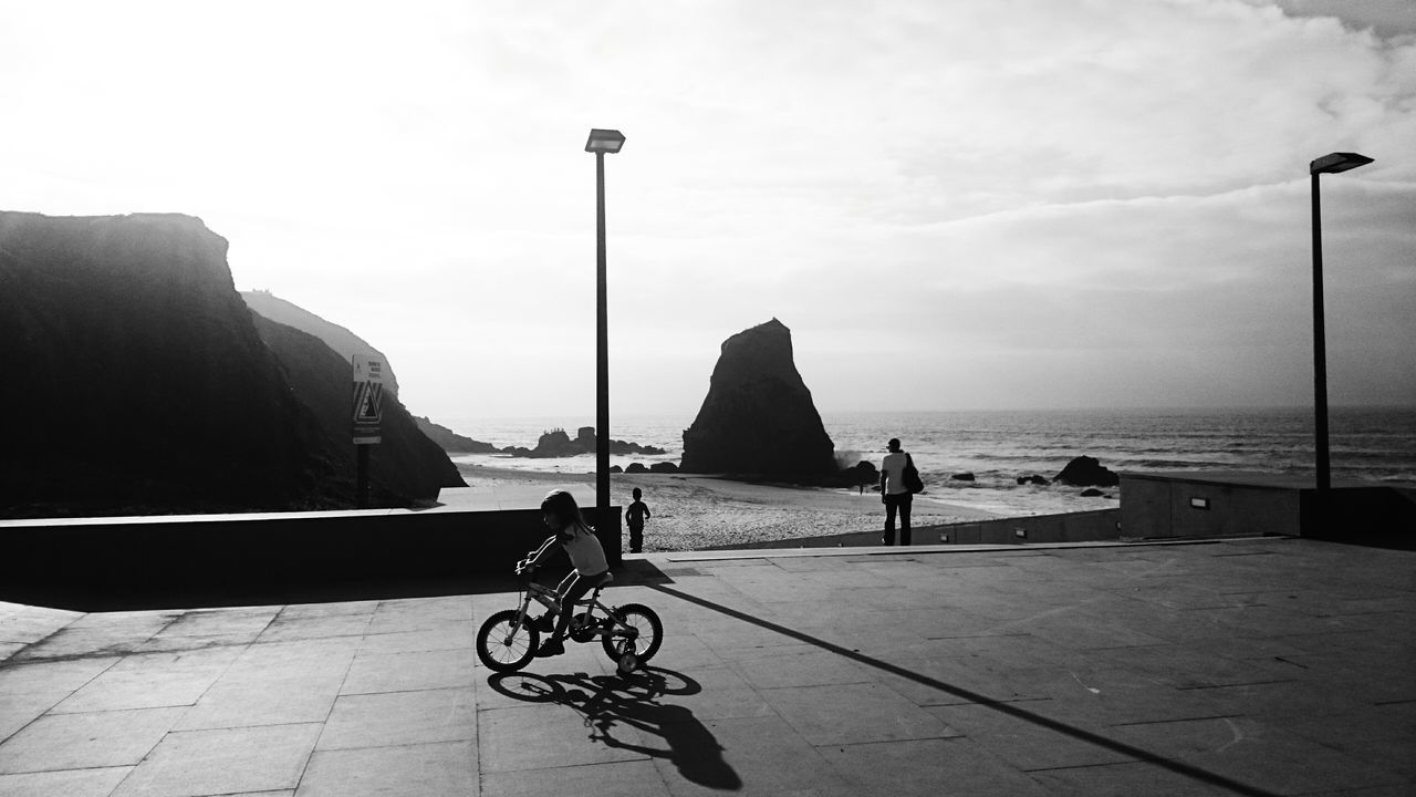 Beachphotography Full Length Leisure Activity Lifestyles Travel Sky Sea Mountain Day Outdoors Tourism Nature Cloud - Sky Riding Land Vehicle Transportation Bicycle Shadow Mode Of Transport Men Calm Blackandwhite Ocean And Sky