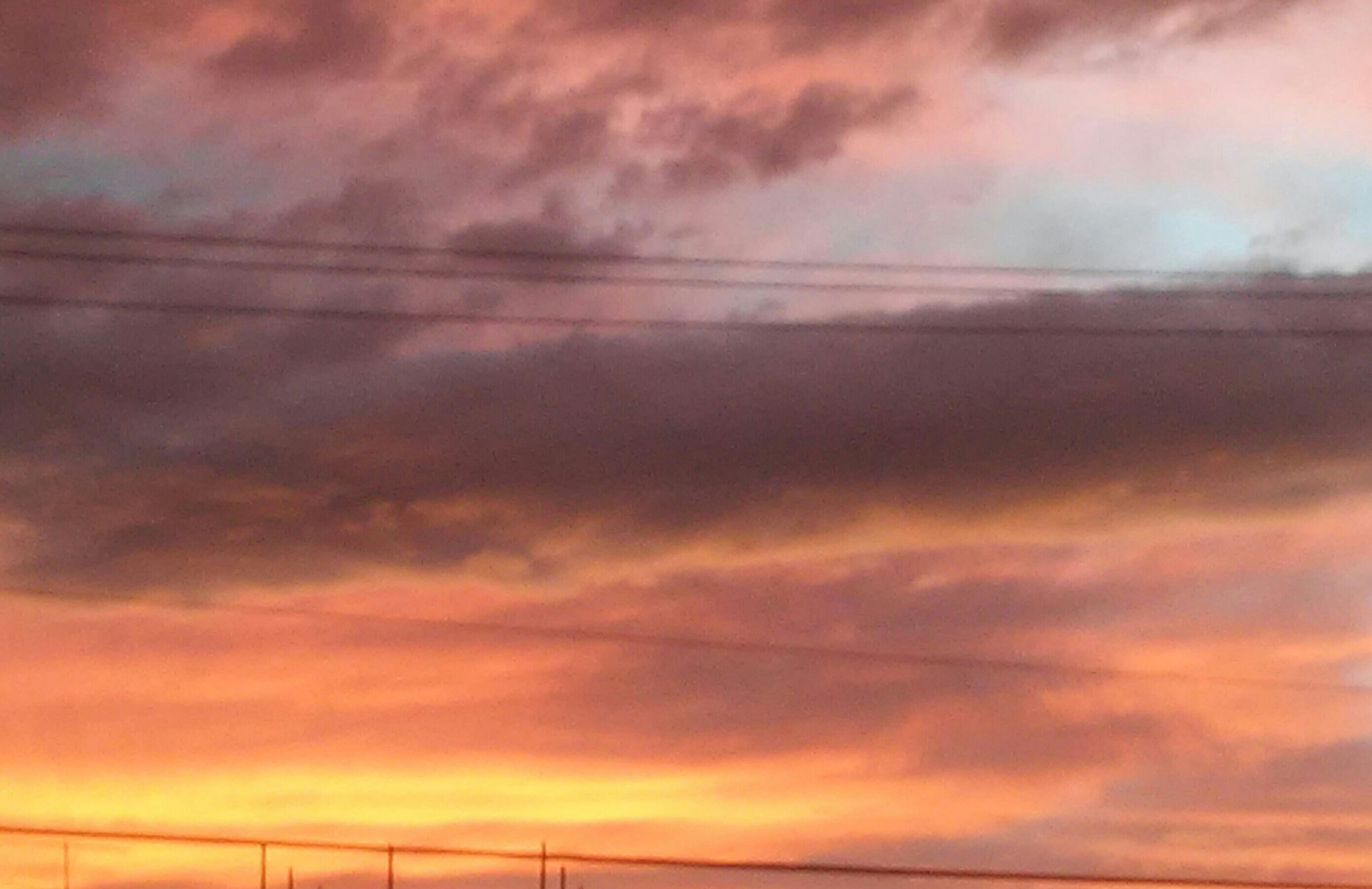 sky, sunset, cloud - sky, low angle view, cloudy, orange color, scenics, beauty in nature, cloud, dramatic sky, tranquility, nature, cloudscape, tranquil scene, weather, sky only, backgrounds, overcast, idyllic, no people