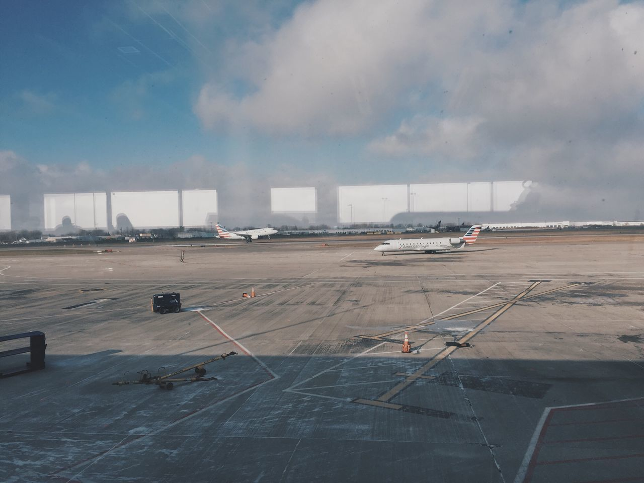 airplane, airport runway, airport, transportation, air vehicle, passenger boarding bridge, cloud - sky, runway, sky, mode of transport, day, commercial airplane, no people, outdoors