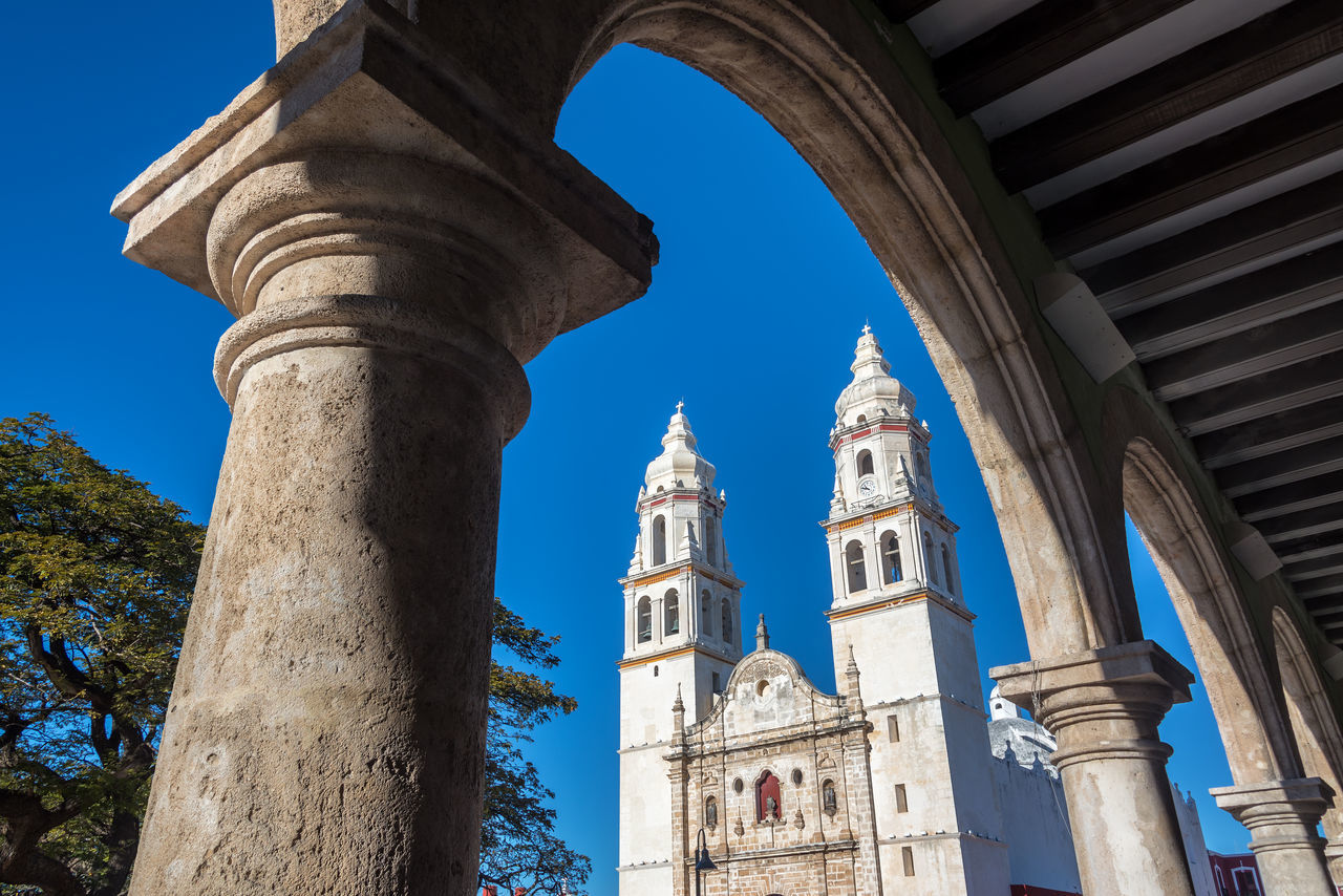 Cathedral in Campeche, Mexico seen through a stone arch America Architecture Building Campeche Caribbean Cathedral Centralamerica Church City Colonial Colorful Day Heritage Latin Mexican Mexico Old Site Street Unesco UNESCO World Heritage Site Urban World Yucatan Mexico Yúcatan