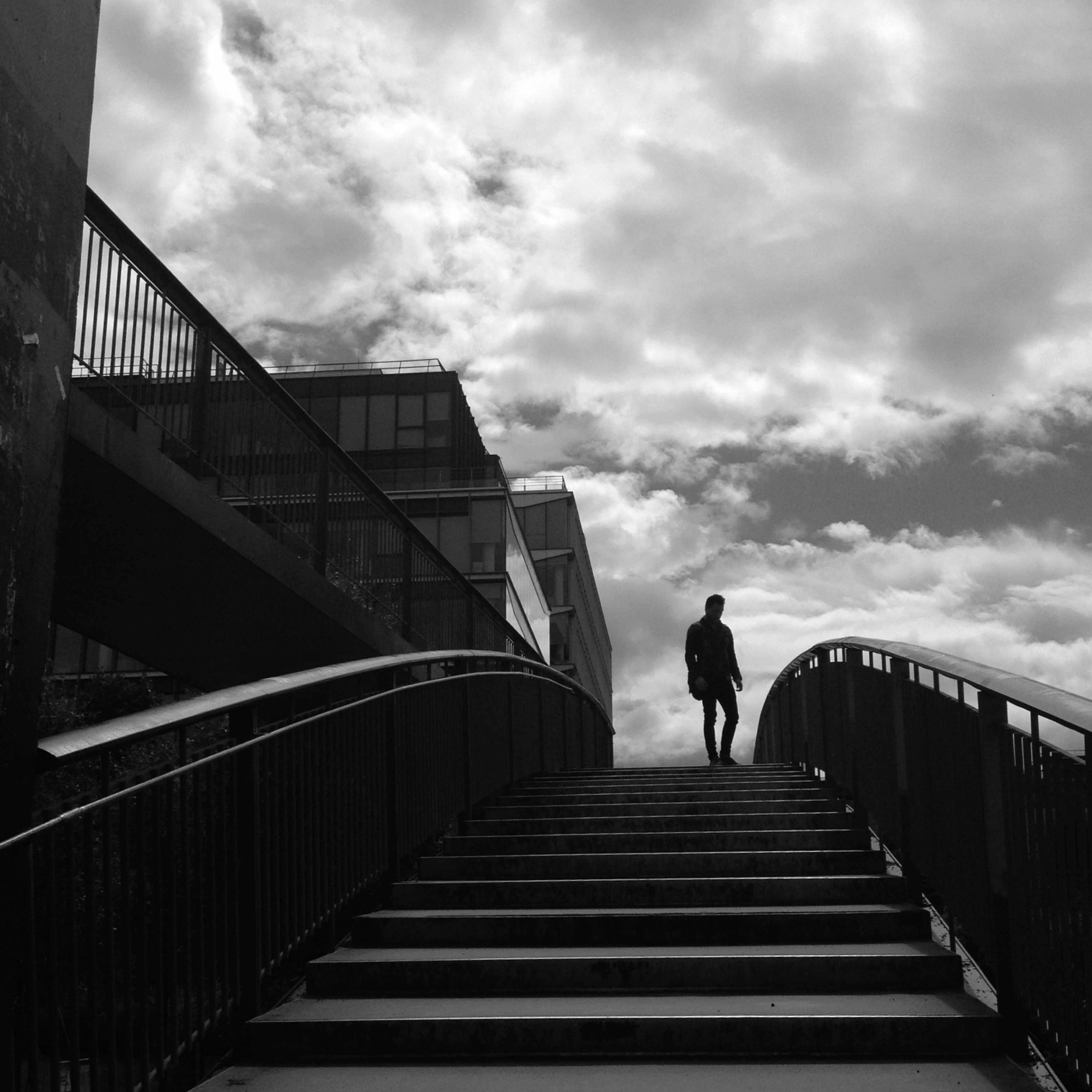built structure, architecture, railing, sky, full length, walking, rear view, men, lifestyles, low angle view, the way forward, steps, silhouette, cloud - sky, leisure activity, building exterior, steps and staircases, person