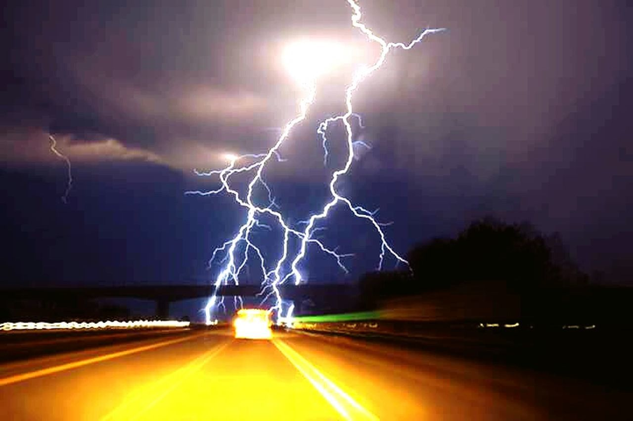 lightning, thunderstorm, power in nature, storm, danger, dramatic sky, night, forked lightning, illuminated, storm cloud, weather, street, road, speed, outdoors, motion, scenics, nature, no people, beauty in nature, sky, cyclone