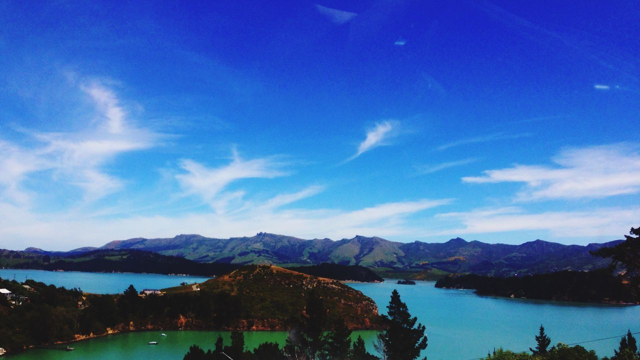water, blue, mountain, scenics, beauty in nature, sky, tranquil scene, tranquility, nature, mountain range, lake, no people, day, outdoors