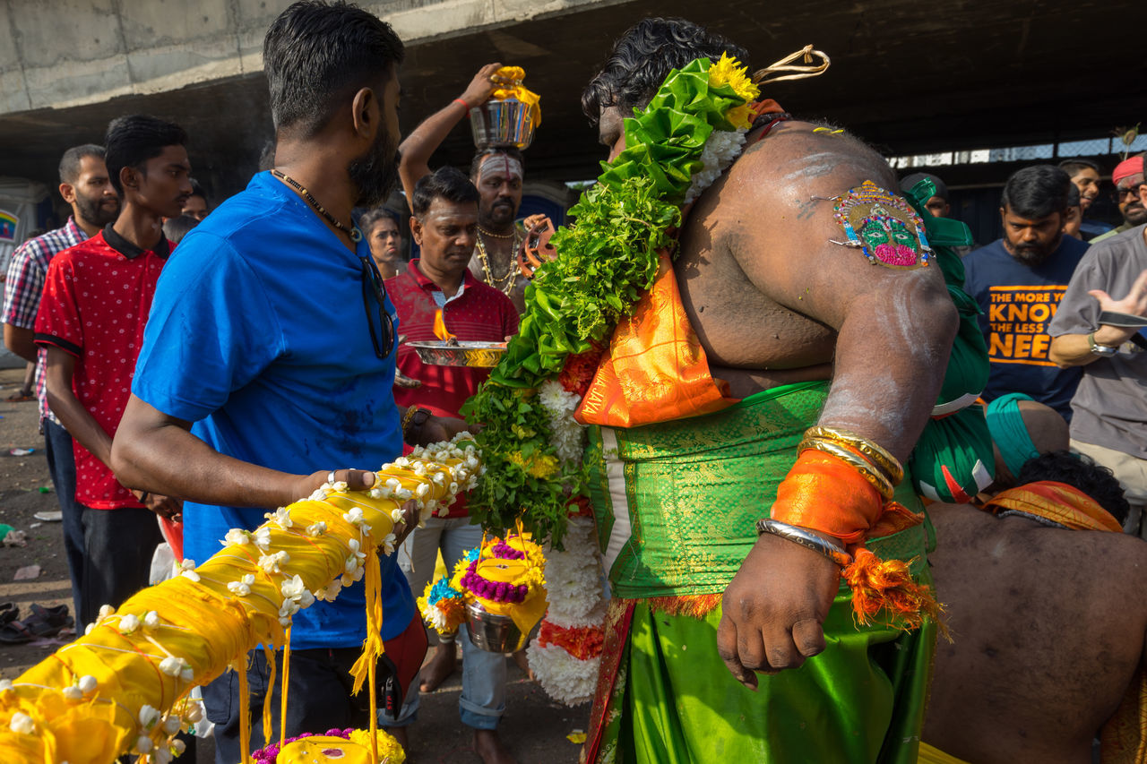 BATU CAVES, MALAYSIA - 9TH FEBRUARY 2017; Hindu devotees performing a pray session during Thaipusam festival in Batu Caves temple, celebrating Lord Murugan victory over the demon Soorapadman. Adult Batu Caves -Malaysia Hindu Temple Hinduism Large Group Of People Men Outdoors People Thaipusam Women