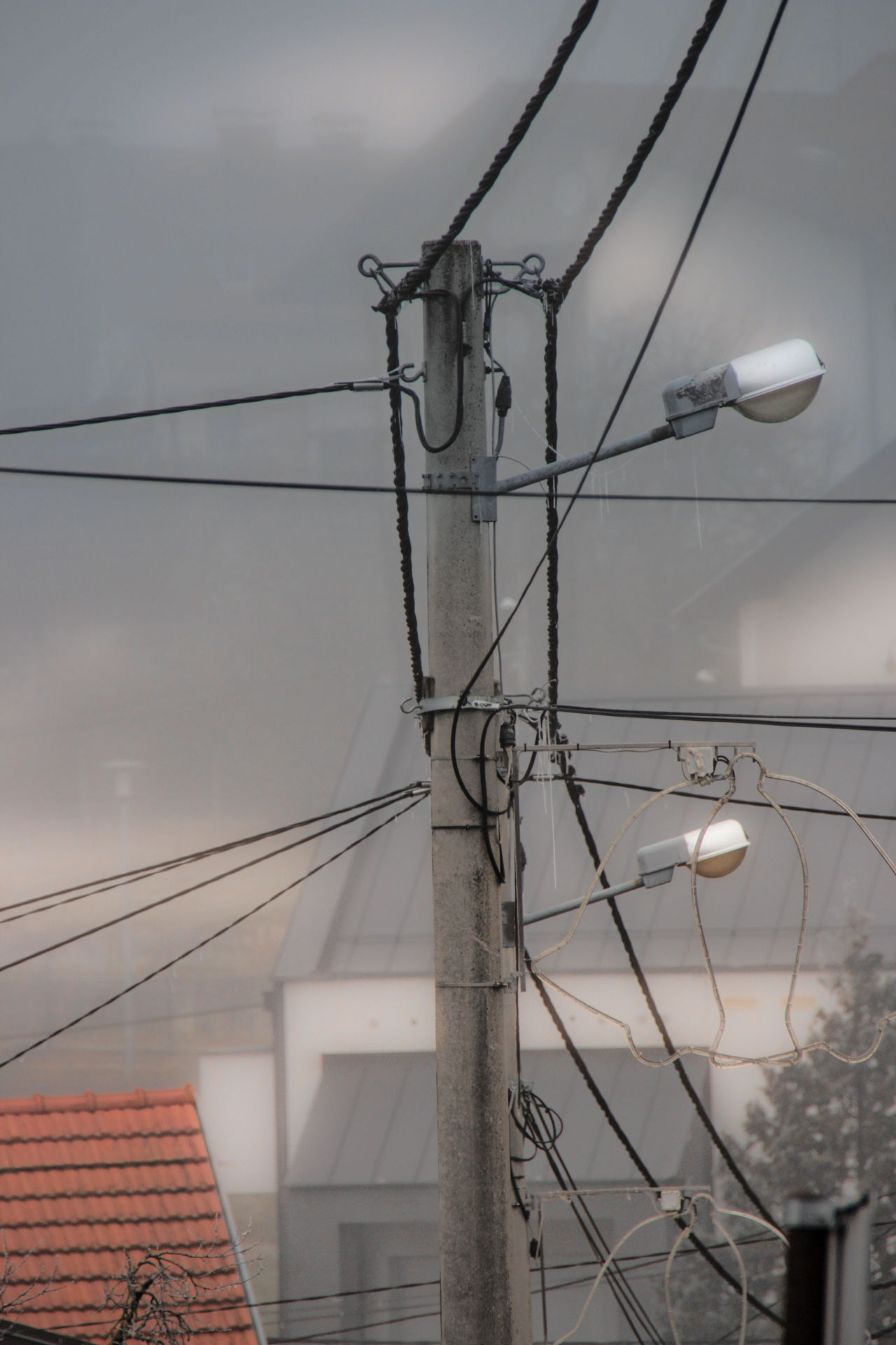 Chaos a.d. Cable Power Supply Power Line  Connection Electricity  Fuel And Power Generation Electricity Pylon Telephone Line Lighting Equipment Sky No People Outdoors Low Angle View Telephone Pole Complexity Technology High Voltage Sign